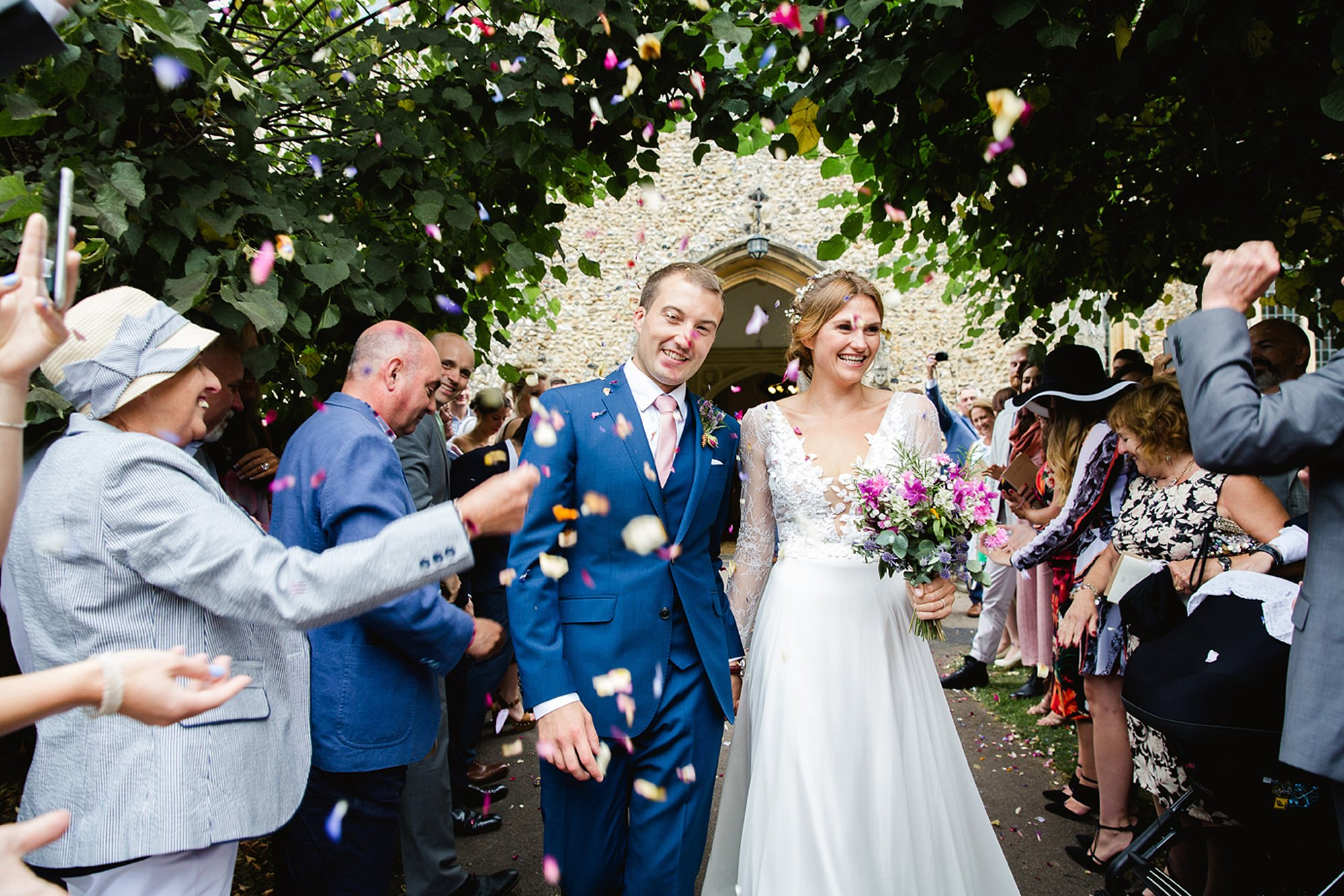 Marks Hall Estate wedding photography bride and groom with confetti
