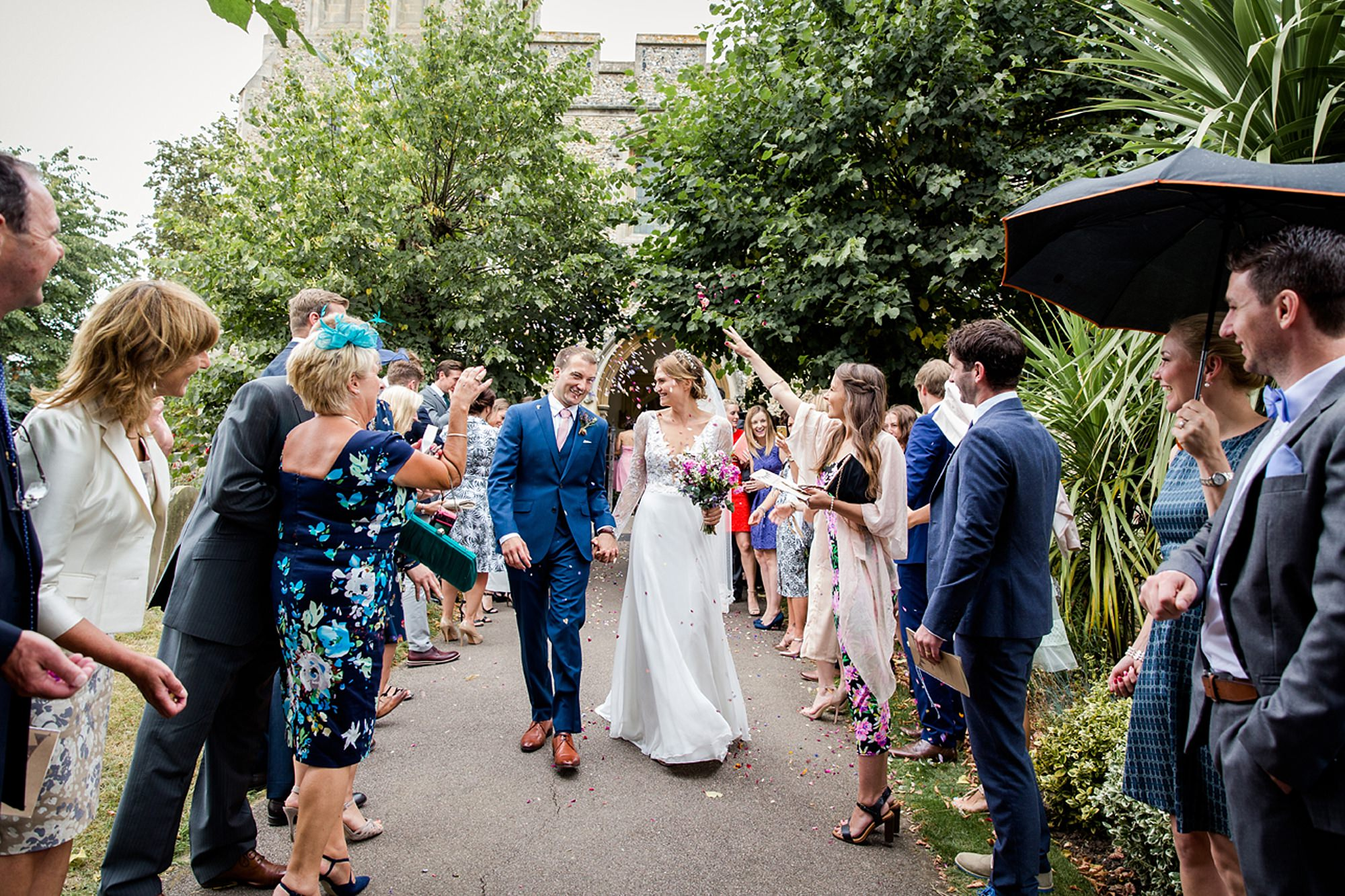 Marks Hall Estate wedding photography bride and groom walking through confetti