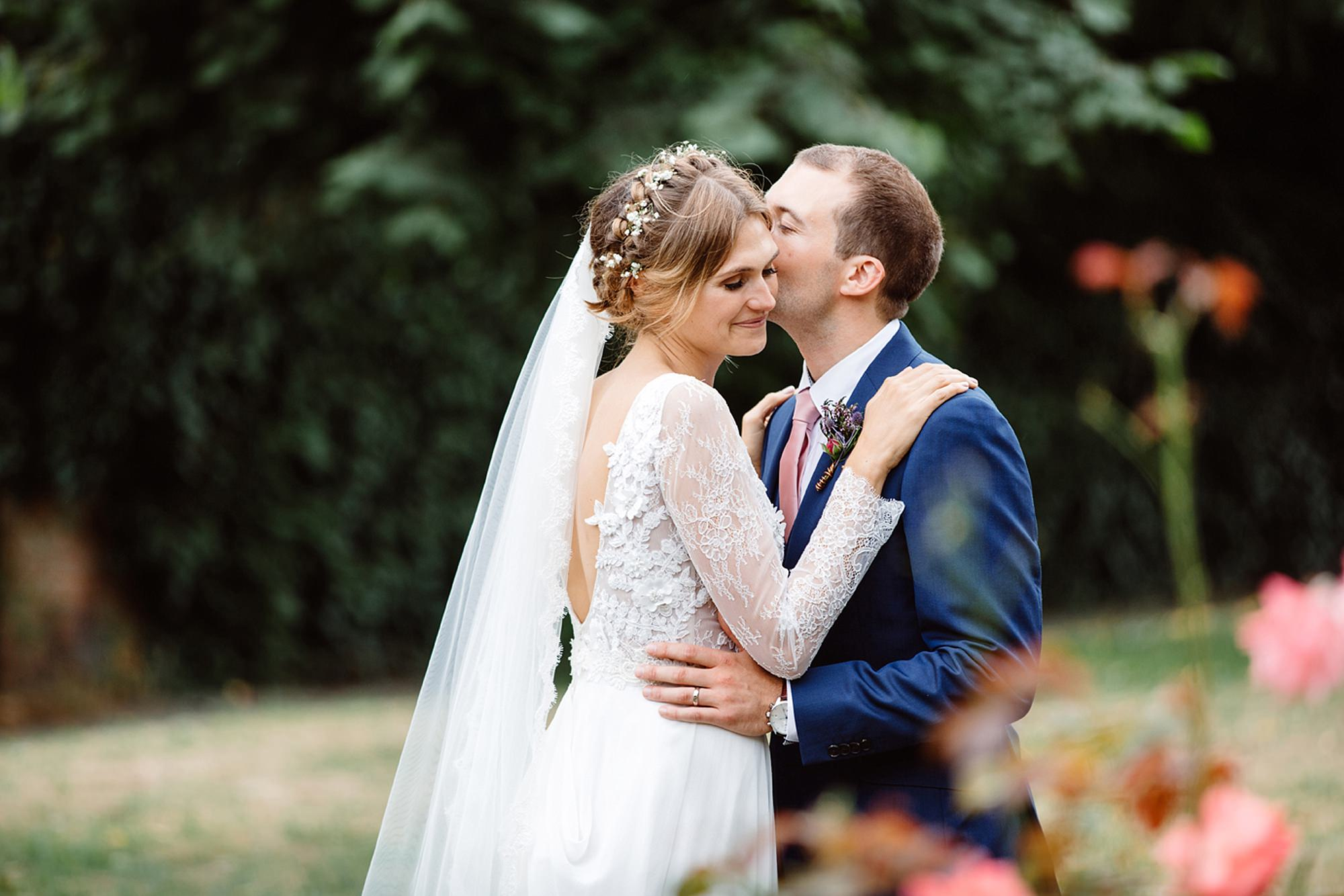 Marks Hall Estate wedding photography groom kissing bride