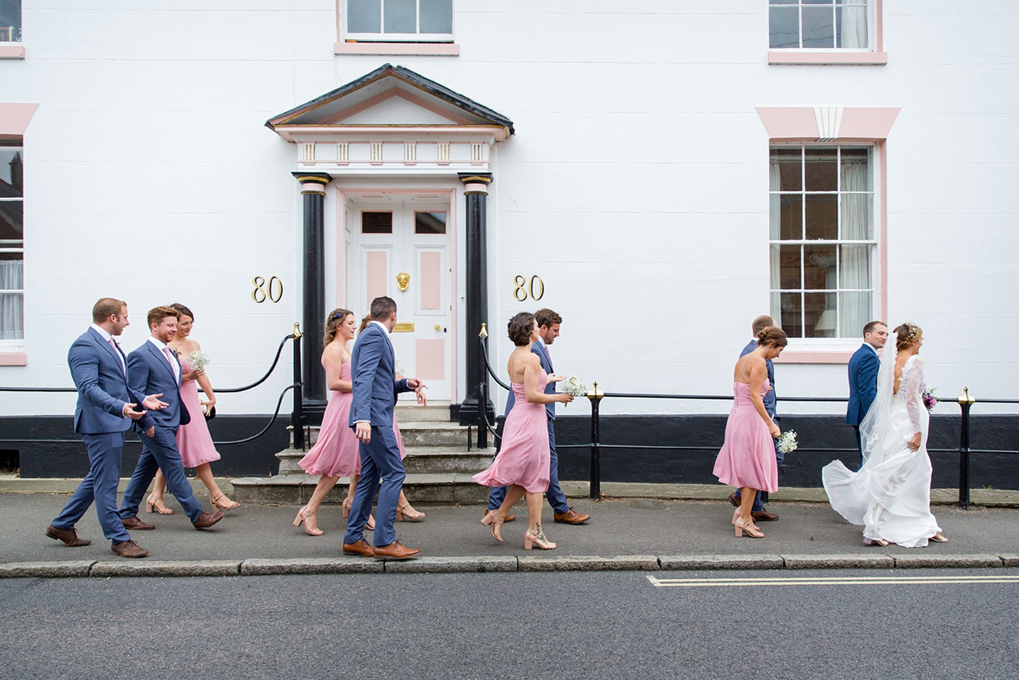 Marks Hall Estate wedding photography bride party walking down street