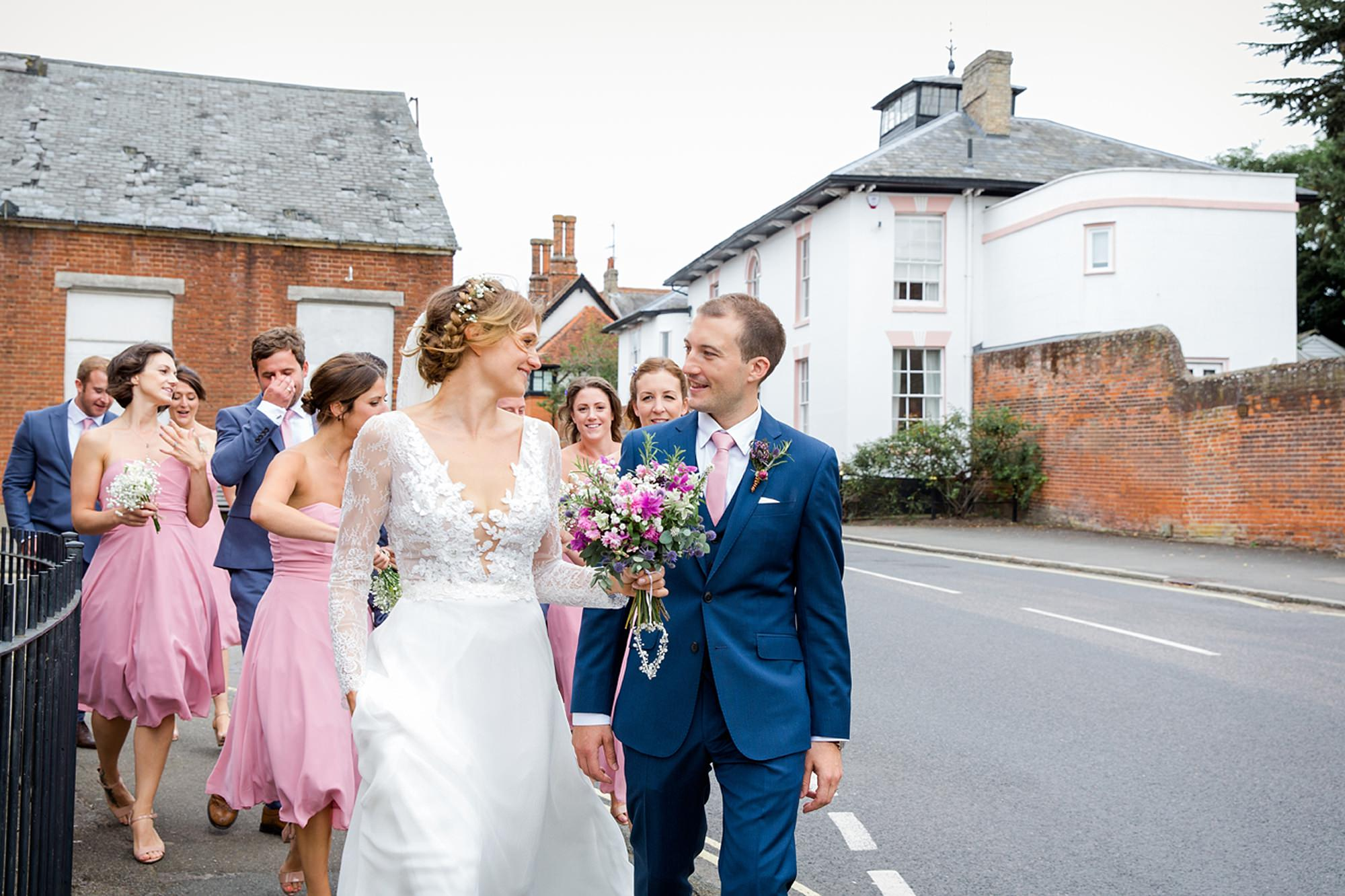 Marks Hall Estate wedding photography bride and groom walking down the street