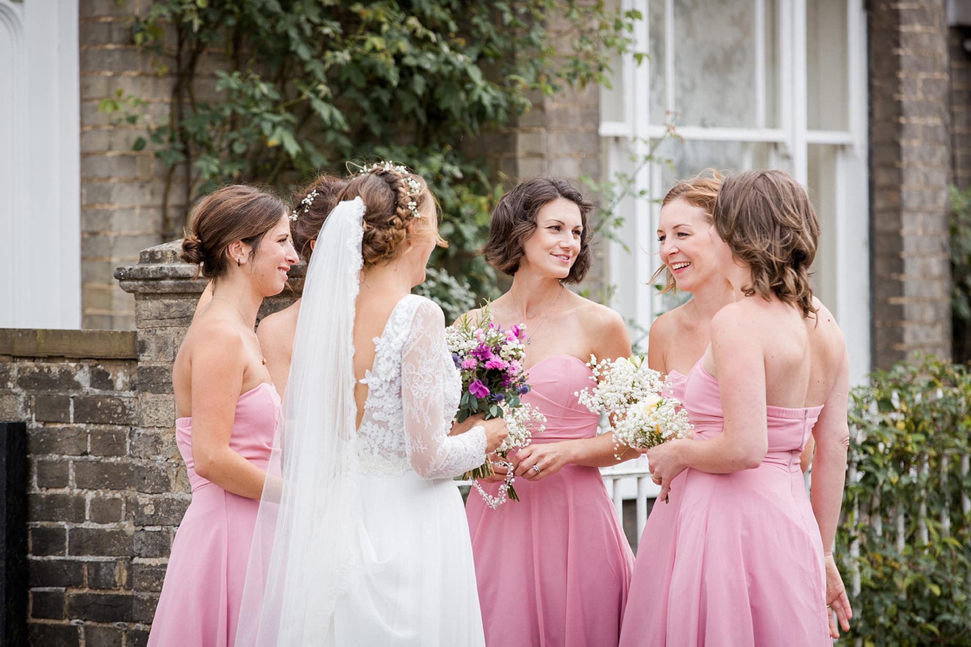 Marks Hall Estate wedding photography bride and bridesmaids outside house