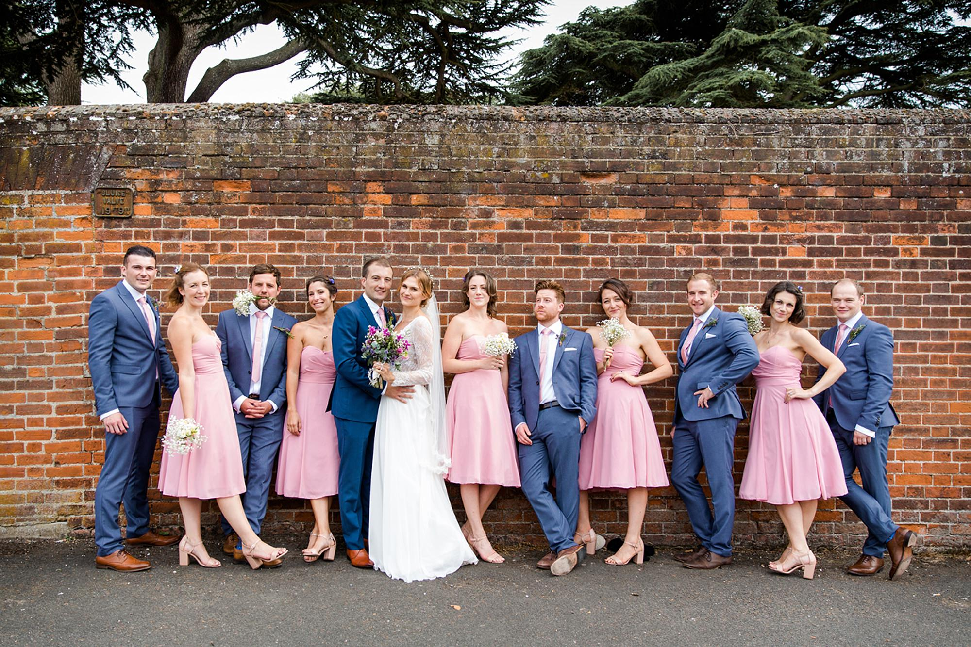 Marks Hall Estate wedding photography portrait of bridal party by wall