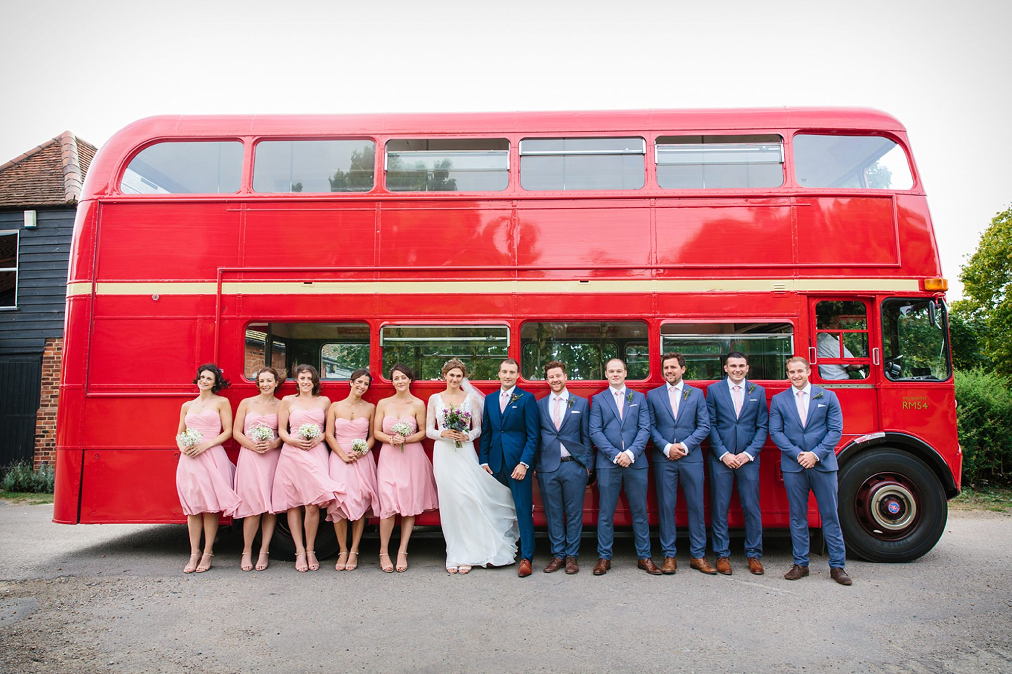 Marks Hall Estate wedding photography bridesmaids and groomsmen in front of vintage bus