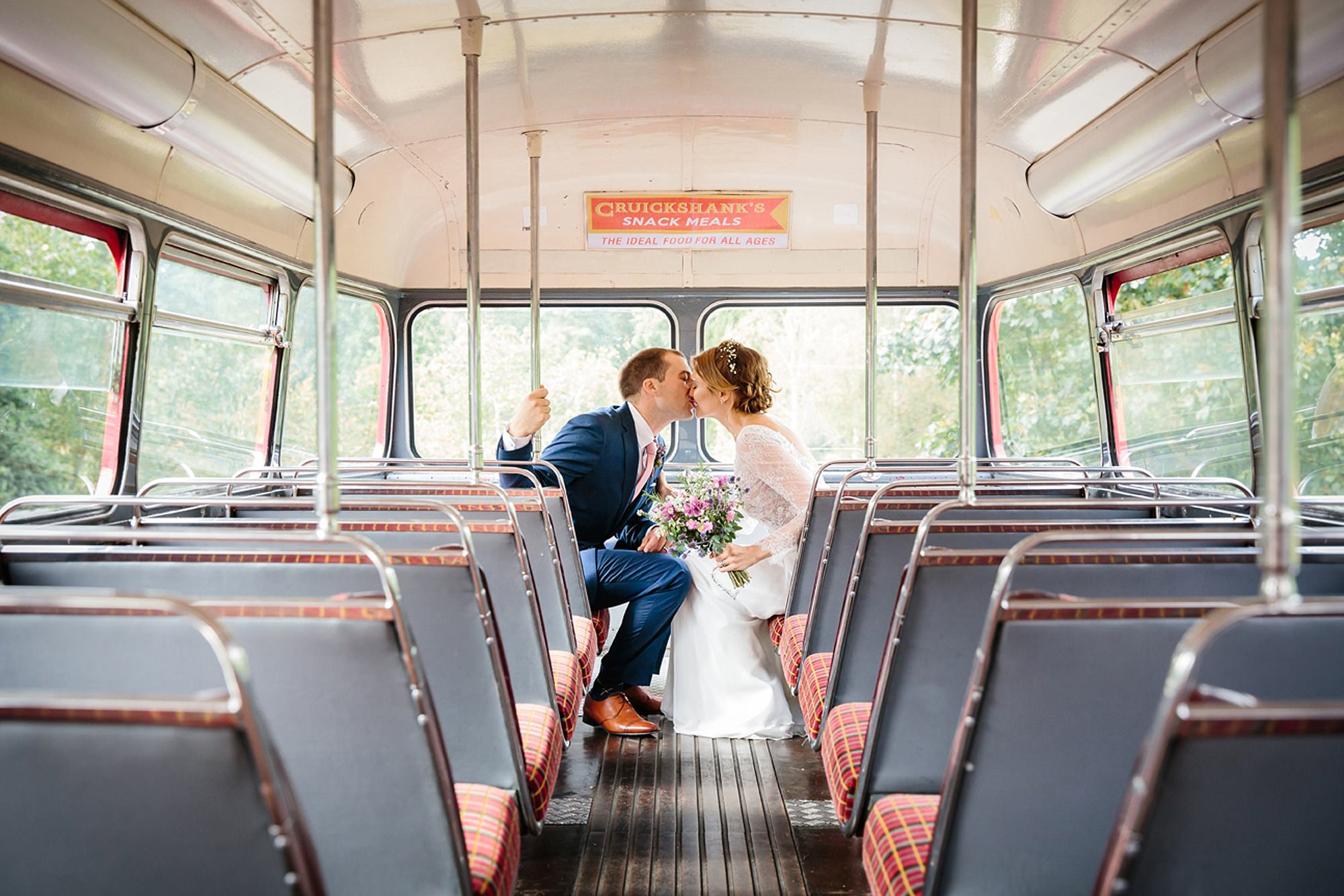 Marks Hall Estate wedding photography bride and groom on vintage london wedding bus