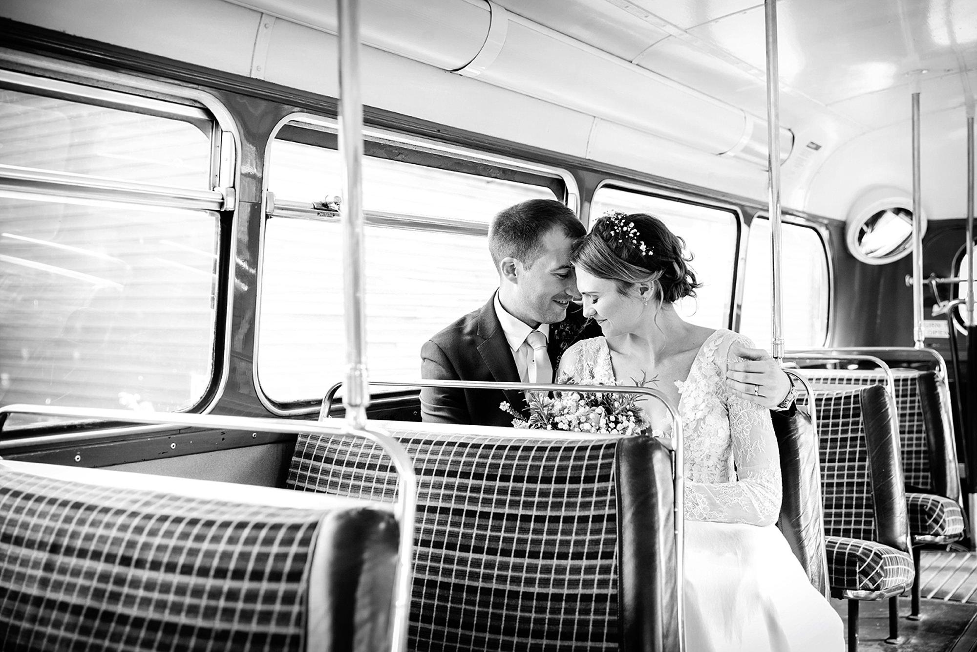 Marks Hall Estate wedding photography bride and groom together on vintage london bus