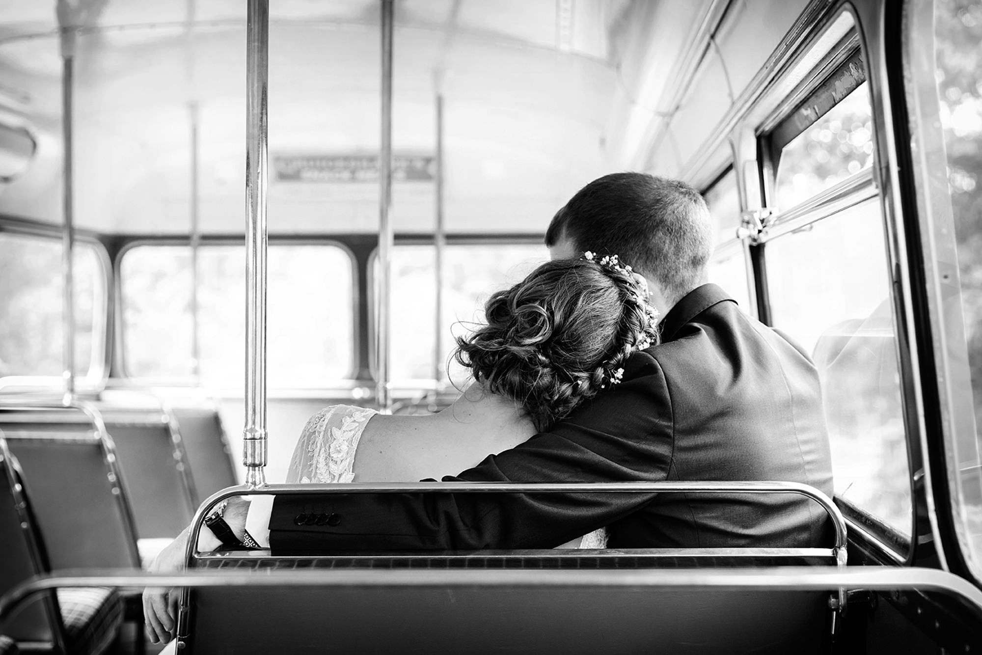 Marks Hall Estate wedding photography back of bride and groom on wedding bus
