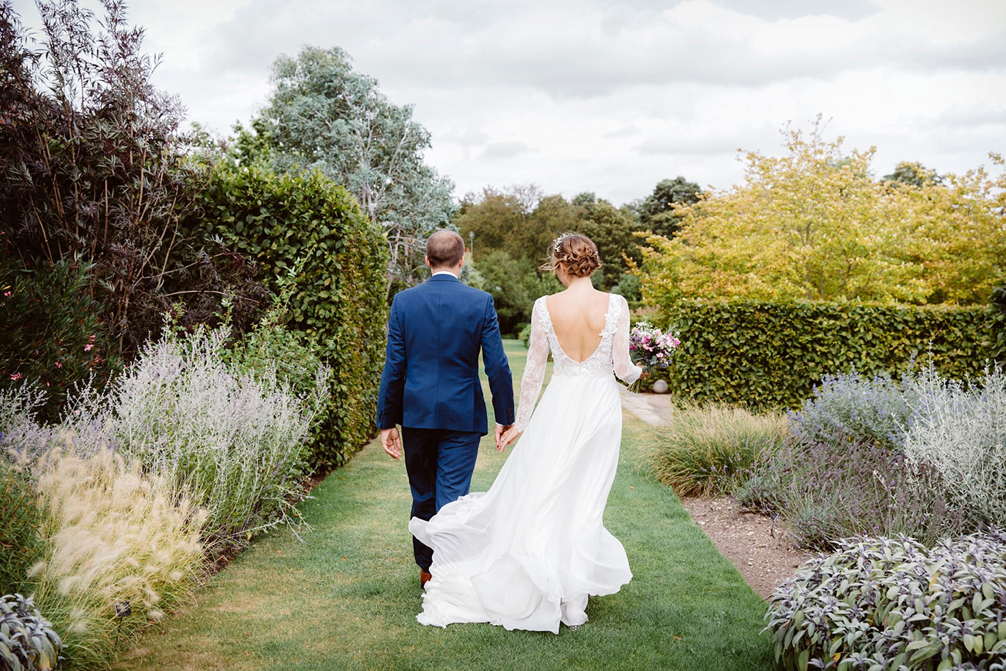 Marks Hall Estate wedding photography bride and groom walking together in marks hall gardens