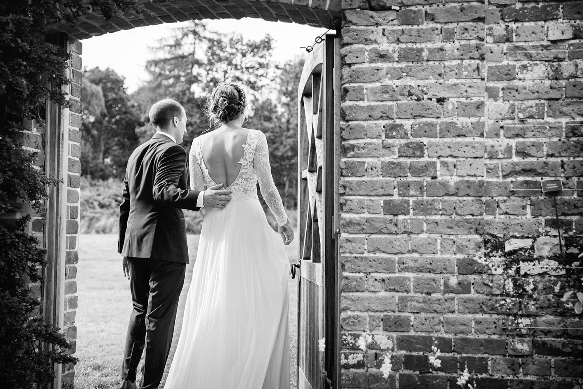 Marks Hall Estate wedding photography bride and groom going through garden door