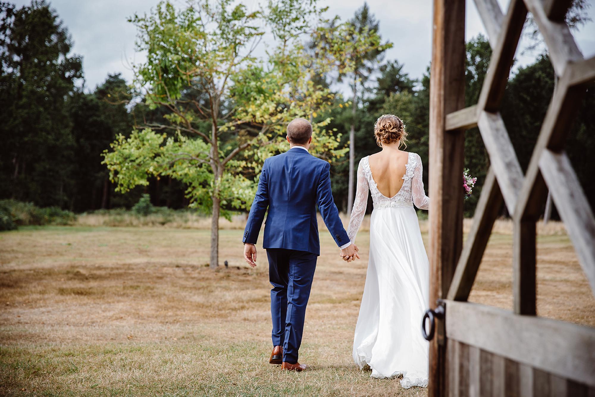 Marks Hall Estate wedding photography bride and groom going through door