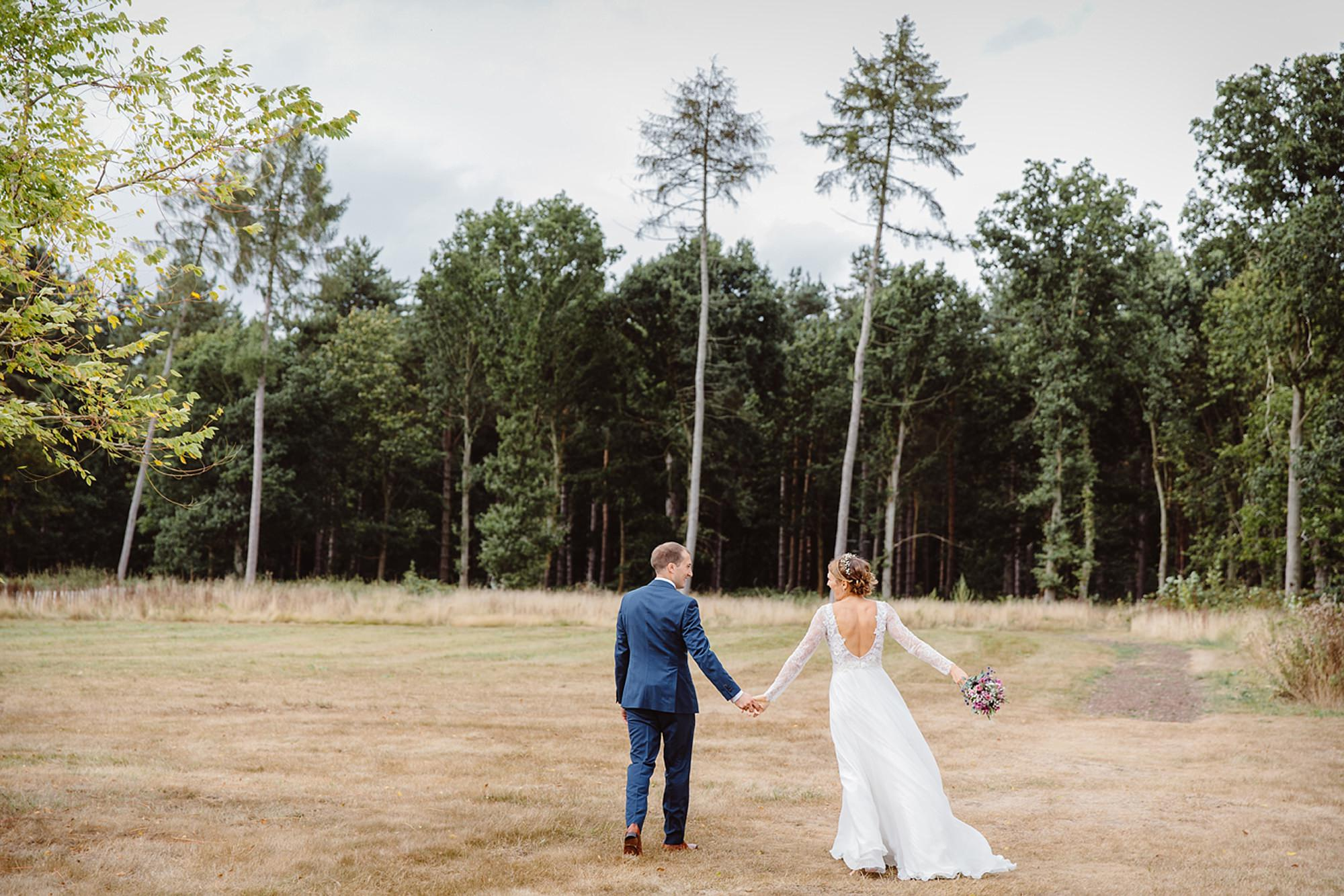 Marks Hall Estate wedding photography bride and groom in field at marks hal estate