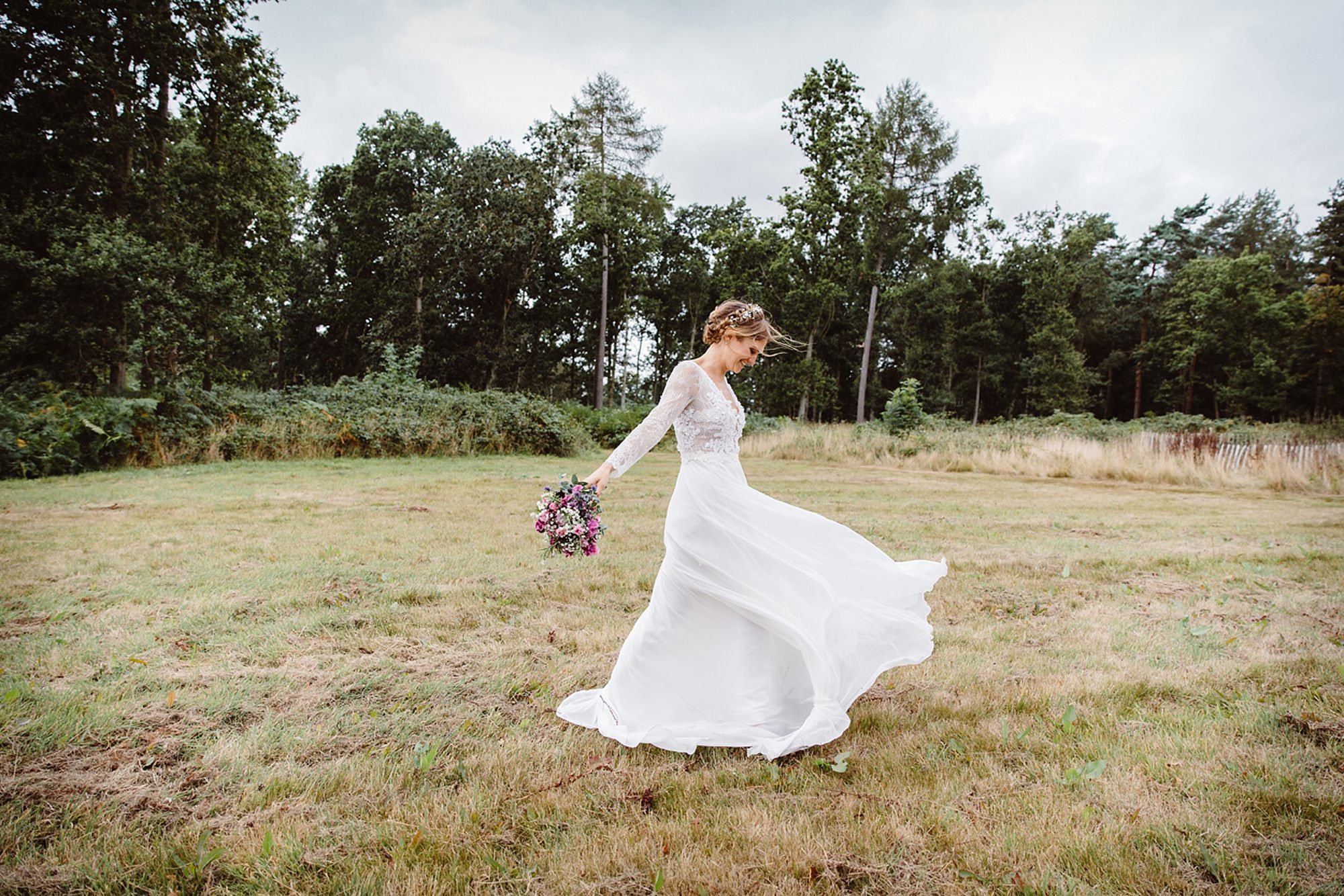 Marks Hall Estate wedding photography bride with her wedding dress blowing in the wind