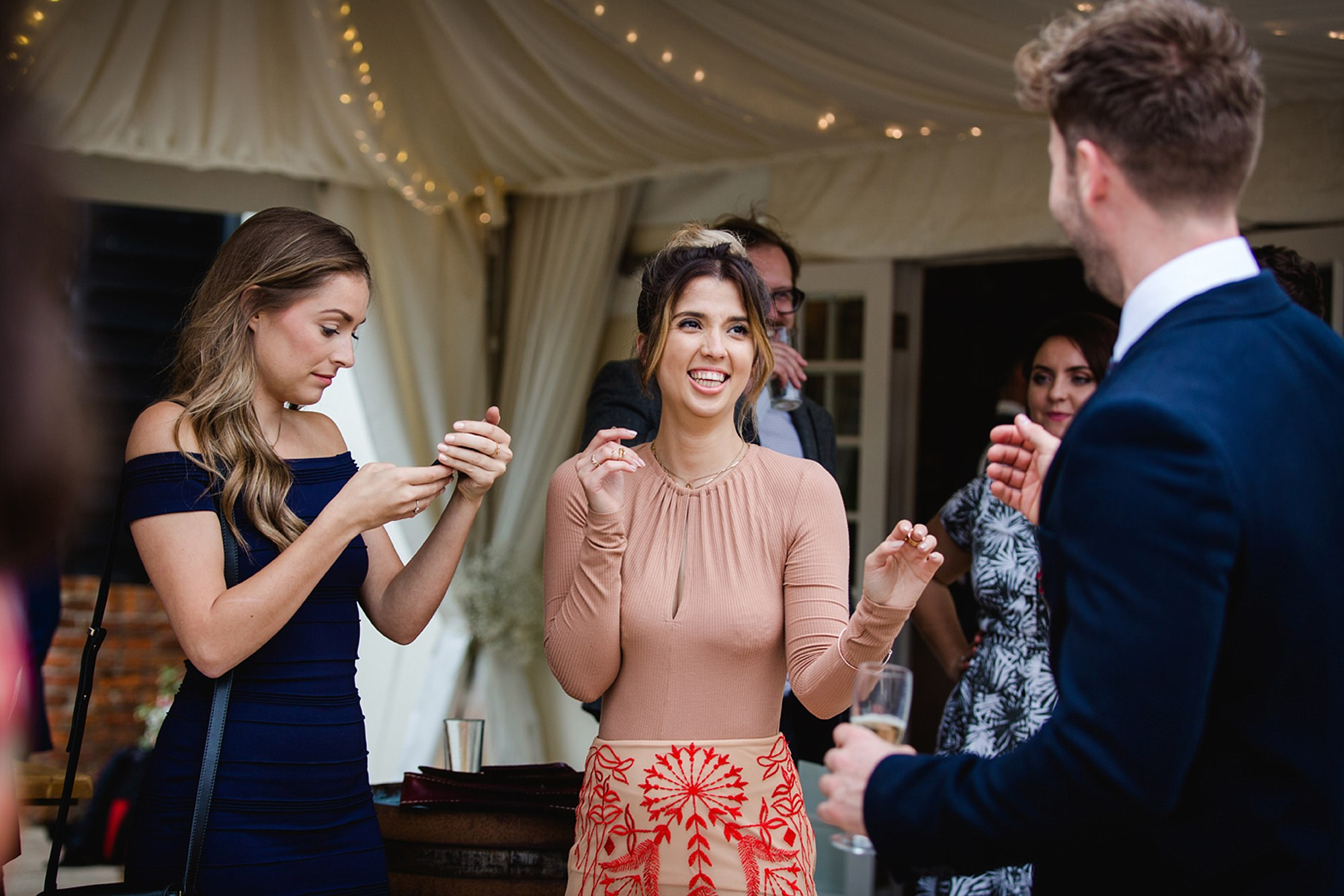 Marks Hall Estate wedding photography laughing wedding guest