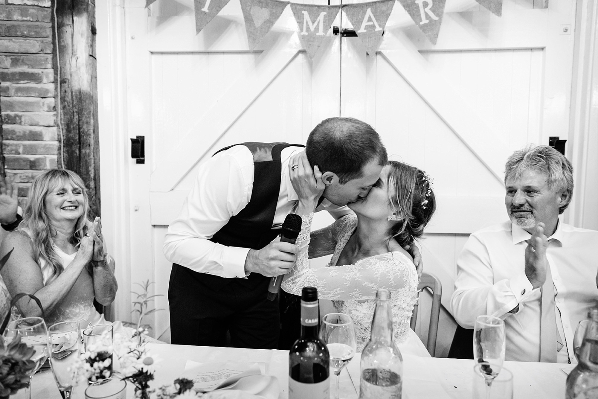 Marks Hall Estate wedding photography bride kissing groom after speech