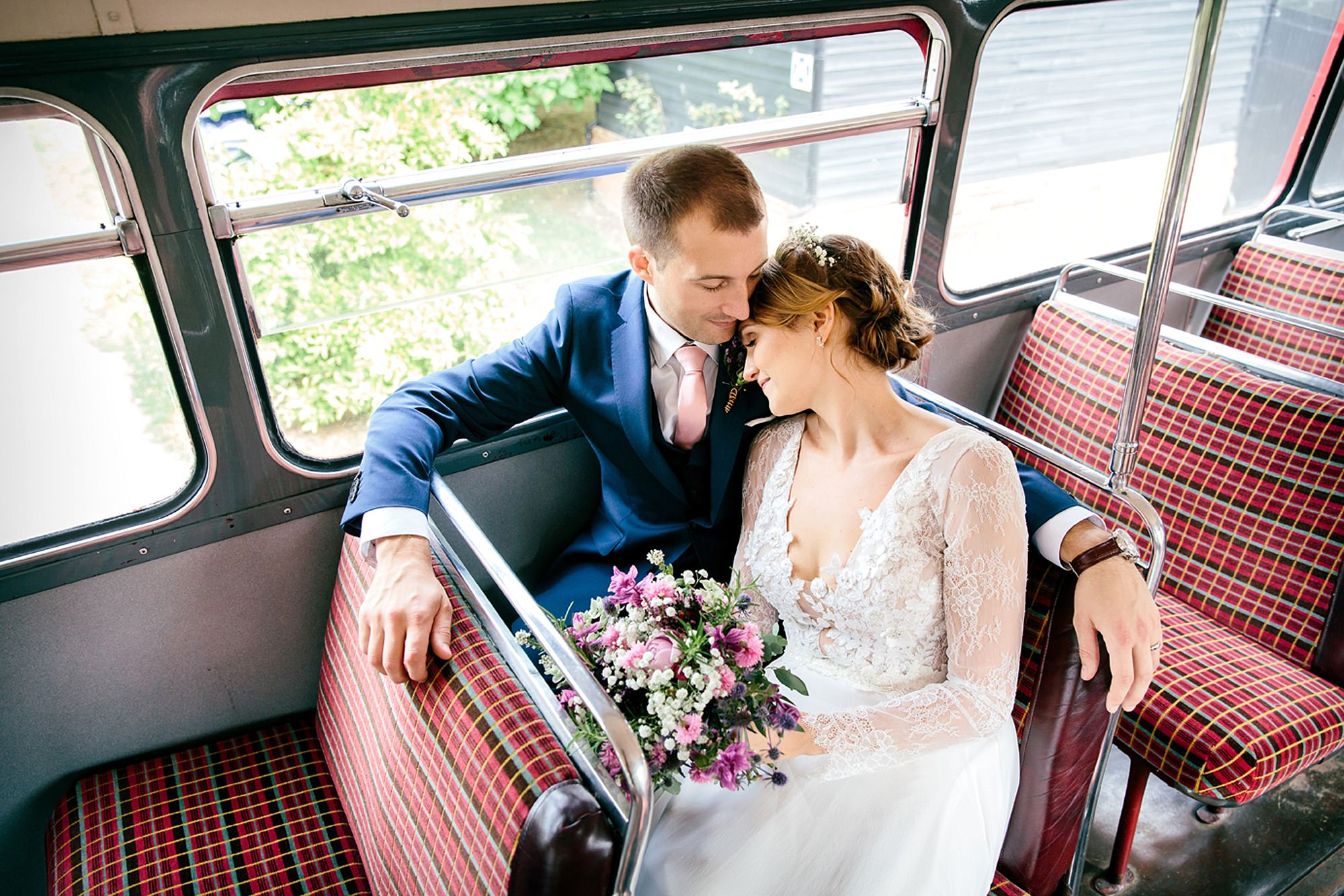 Marks Hall estate wedding photography bride and groom in wedding bus
