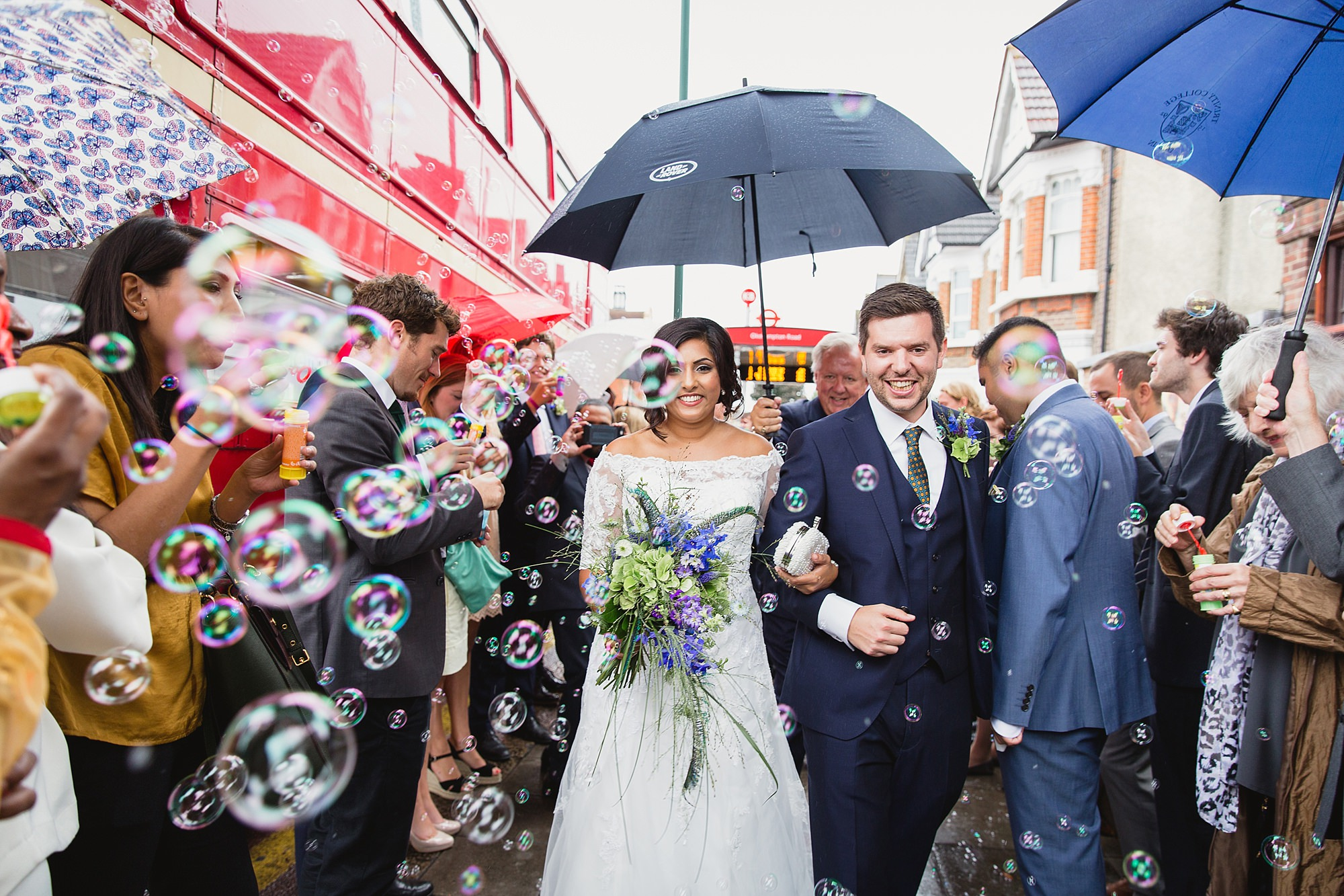 Paradise by way of Kensal Green wedding bride and groom amongst confetti bubbles