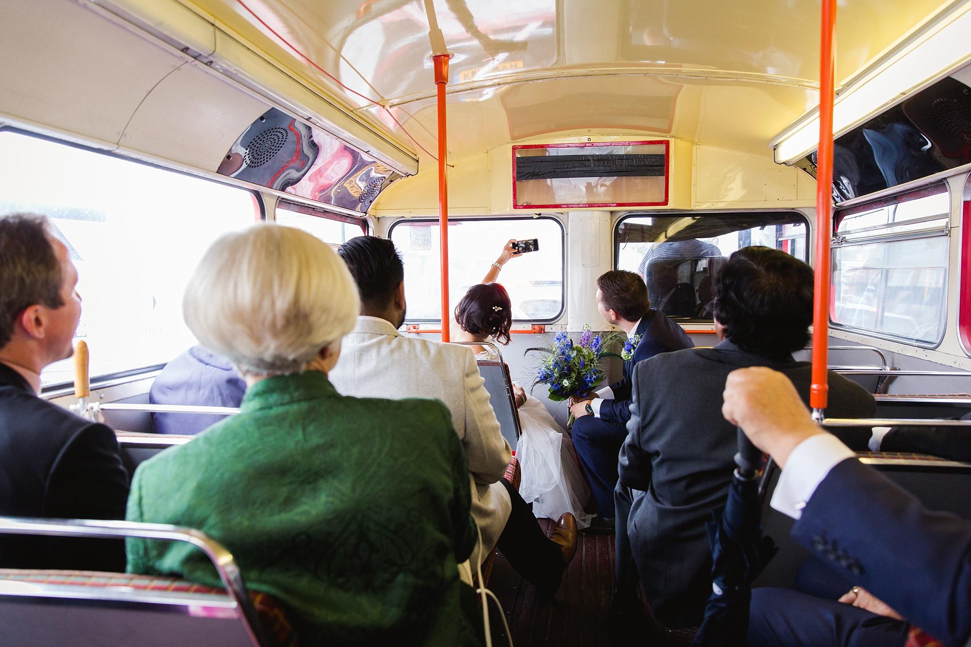 Paradise by way of Kensal Green wedding bride and groom selfie on bus