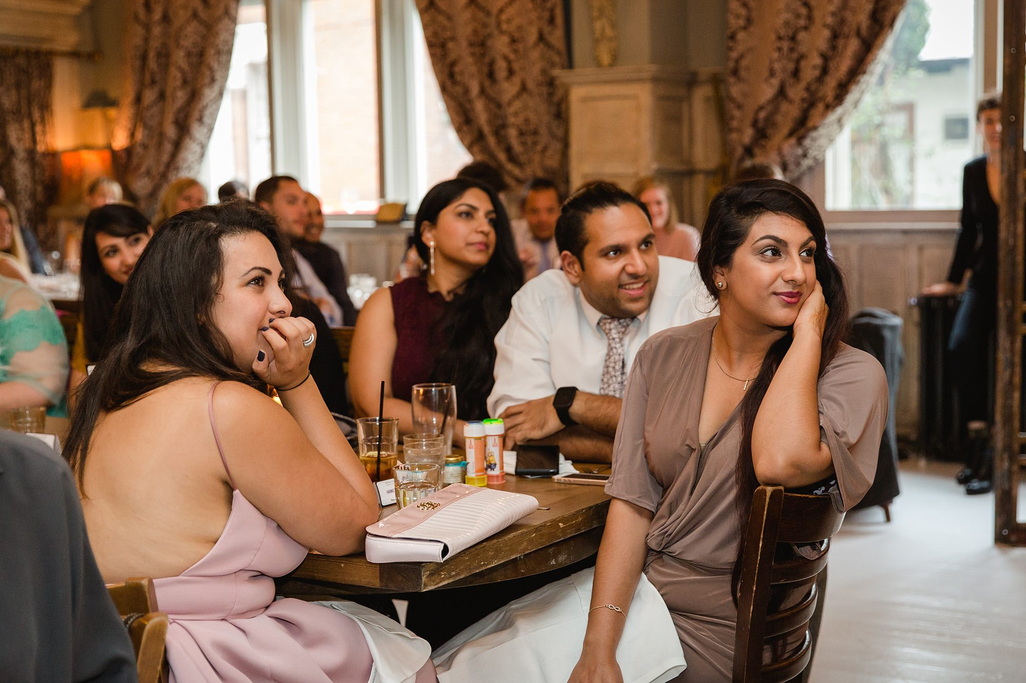 Paradise by way of Kensal Green wedding guests listening to speech