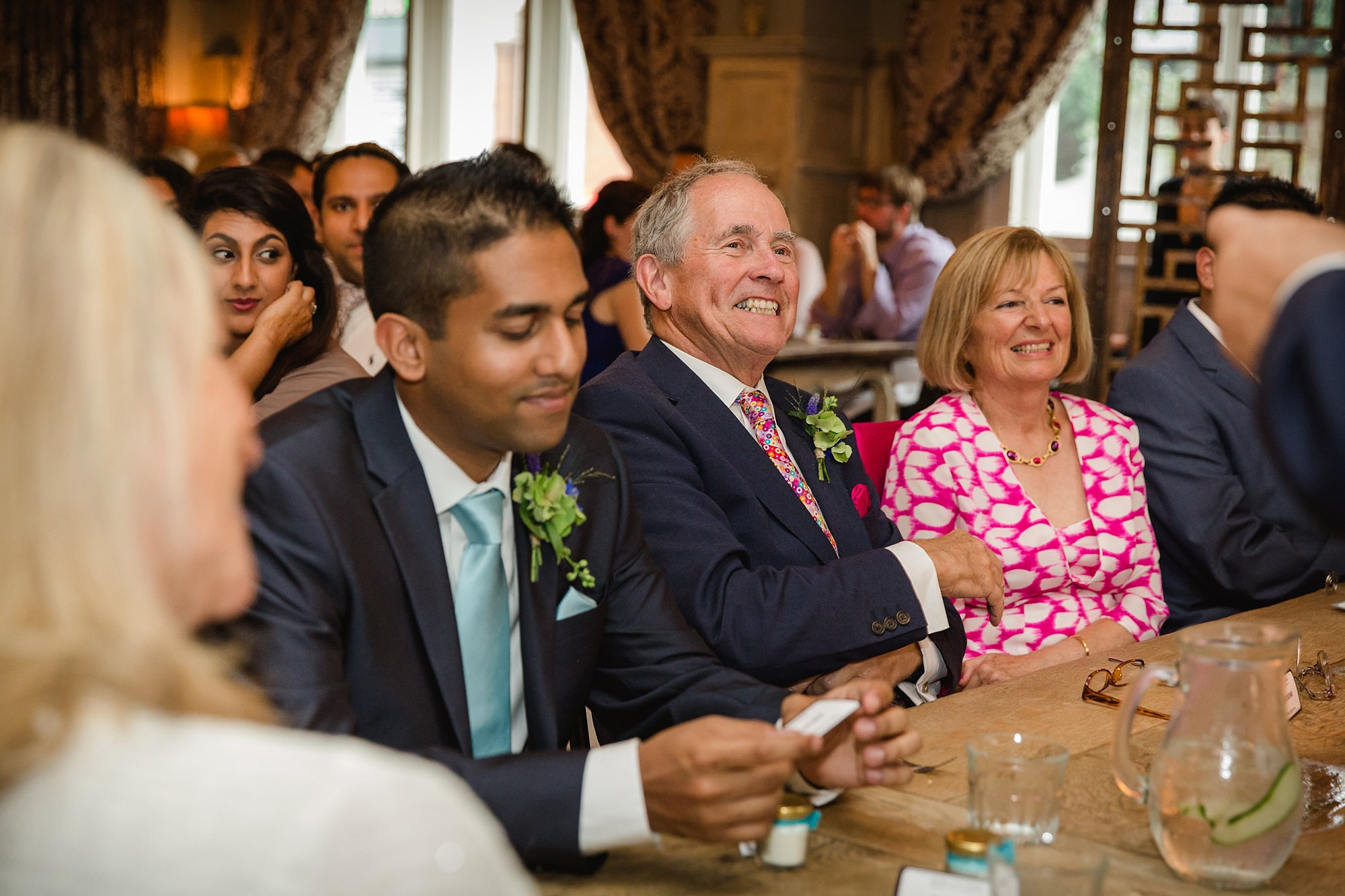 Paradise by way of Kensal Green wedding guests laughing during speech