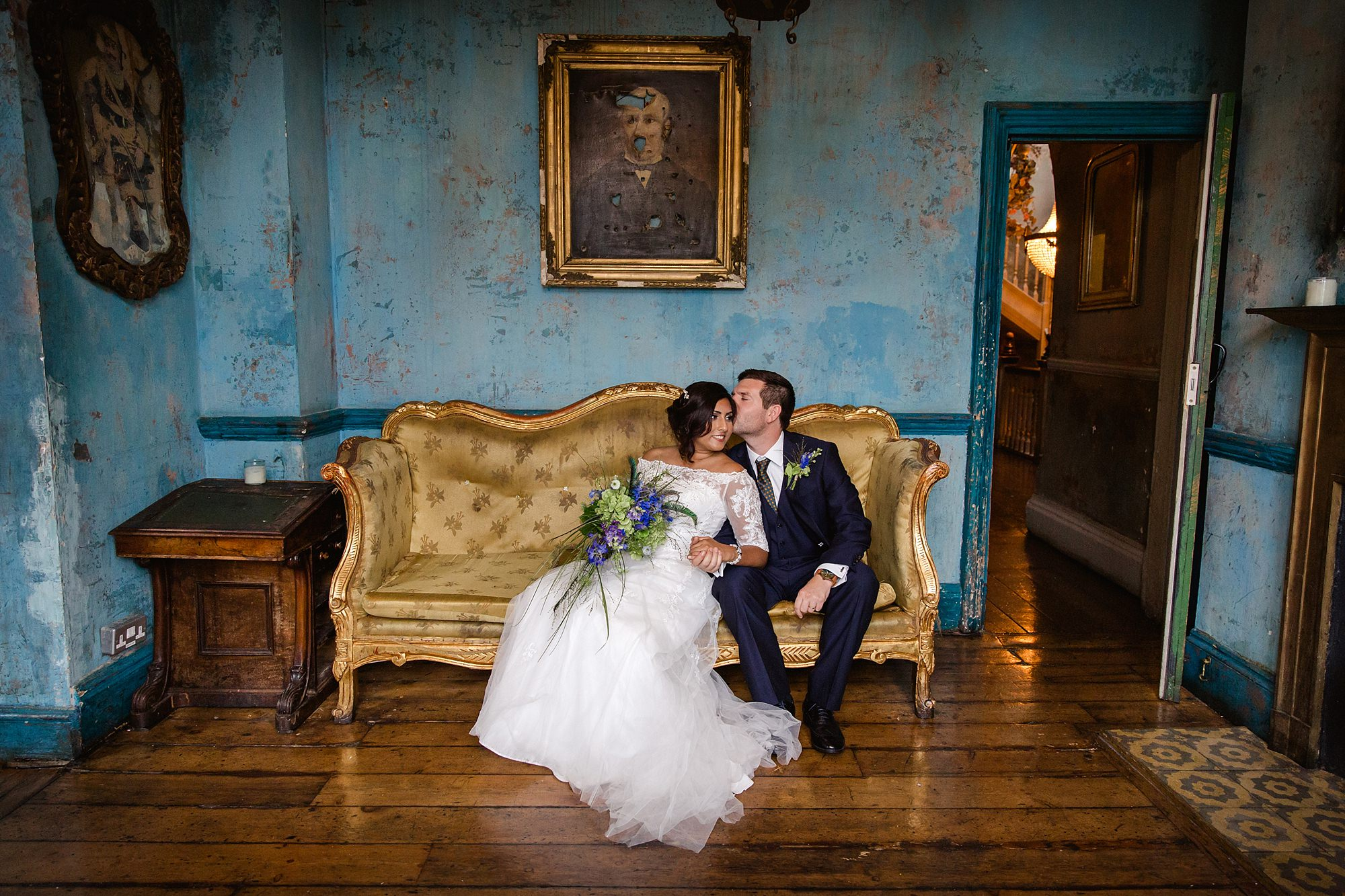 Paradise by way of Kensal Green wedding bride and groom on sofa