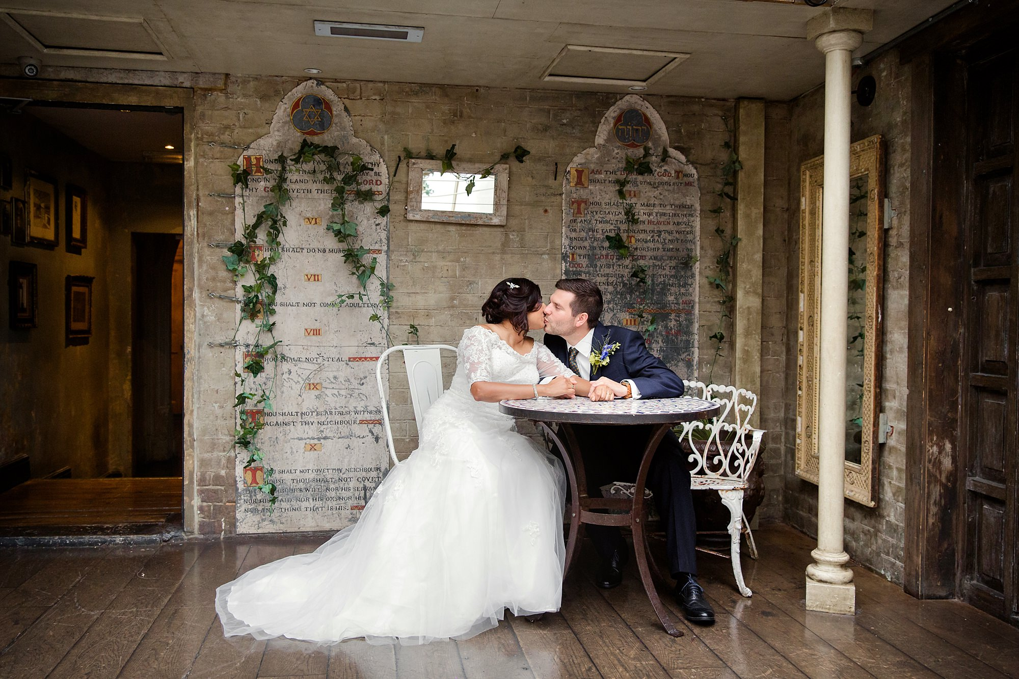 Paradise by way of Kensal Green wedding bride and groom kiss