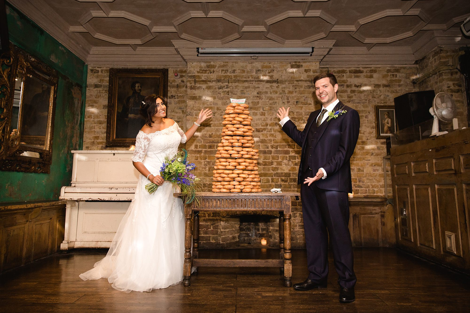 Paradise by way of Kensal Green wedding bride and groom with donut tower