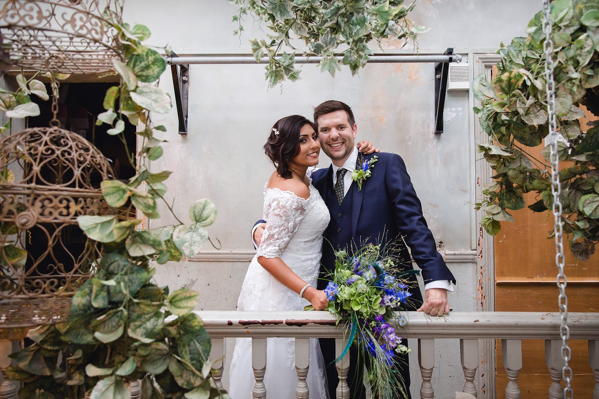 Paradise by way of Kensal Green wedding bride and groom together on balcony