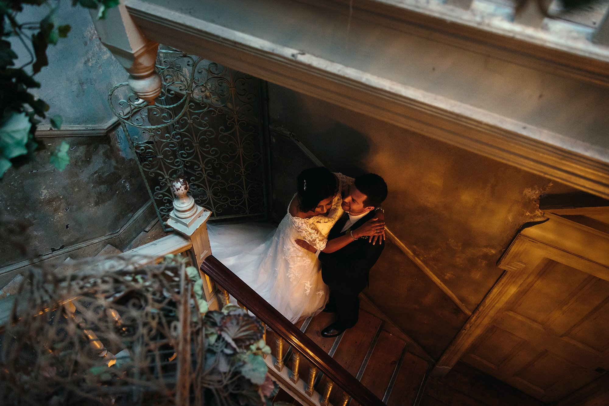 Paradise by way of Kensal Green wedding bride and groom on stairs