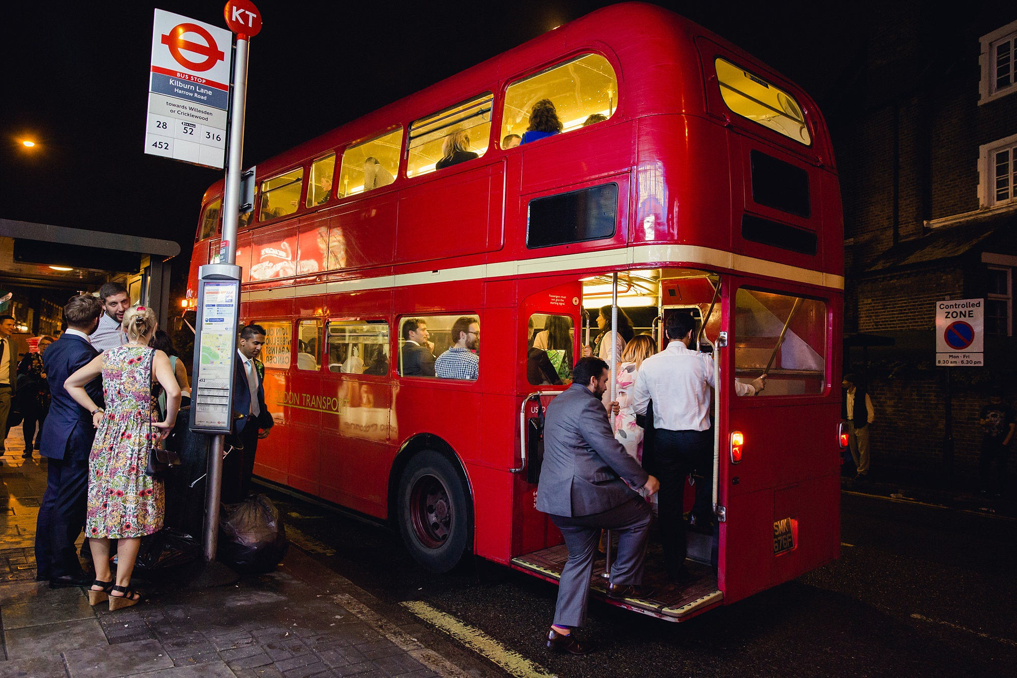 Paradise by way of Kensal Green wedding guests getting on bus