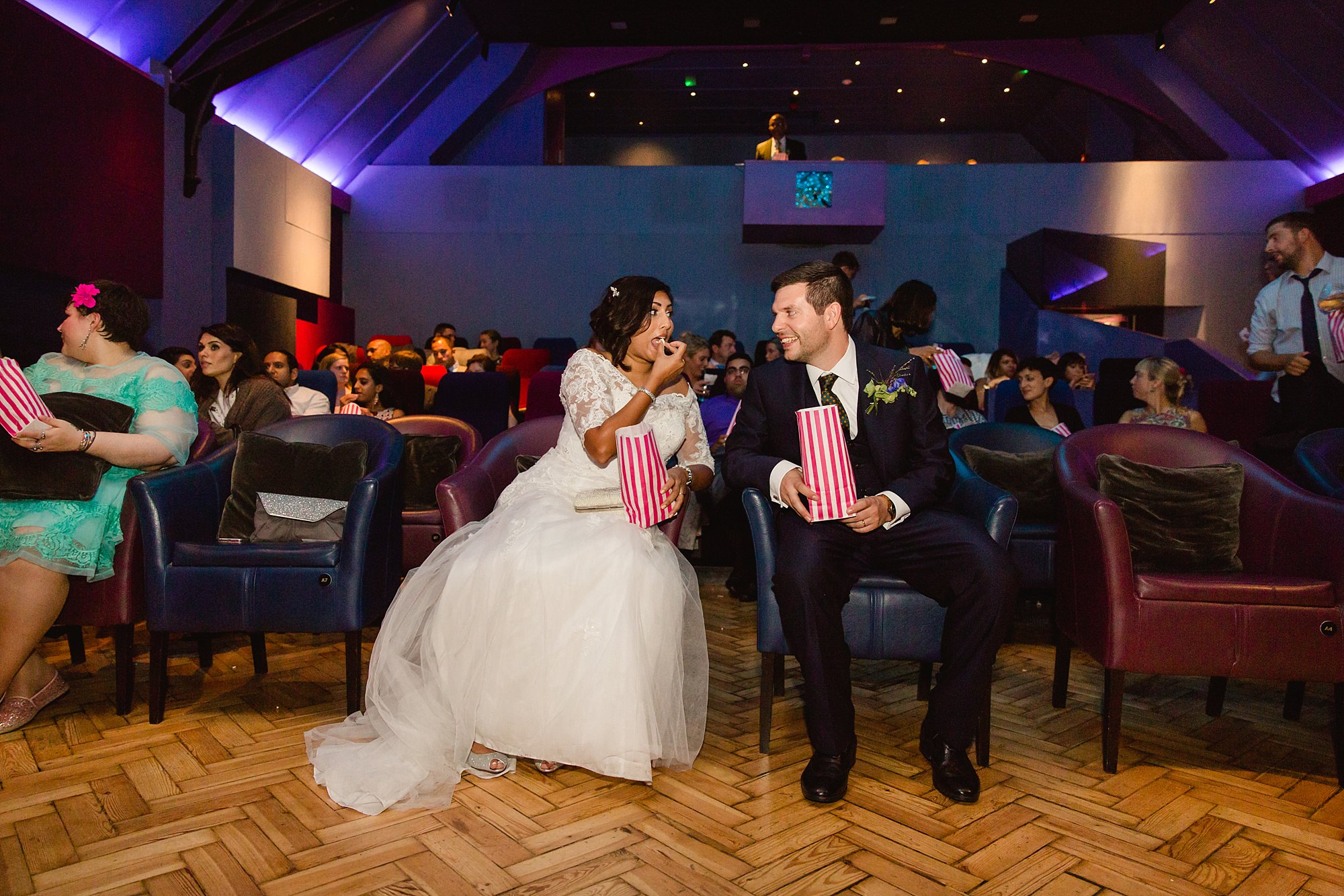 Paradise by way of Kensal Green wedding bride and groom in cinema with popcorn