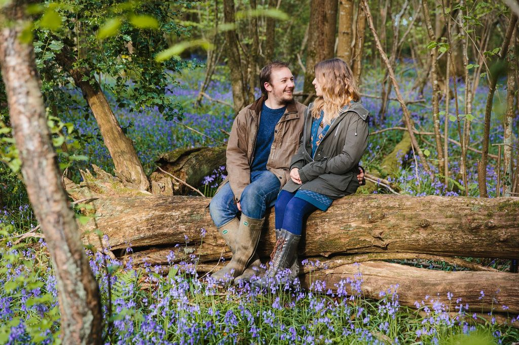 spring engagement shoot couple in forest