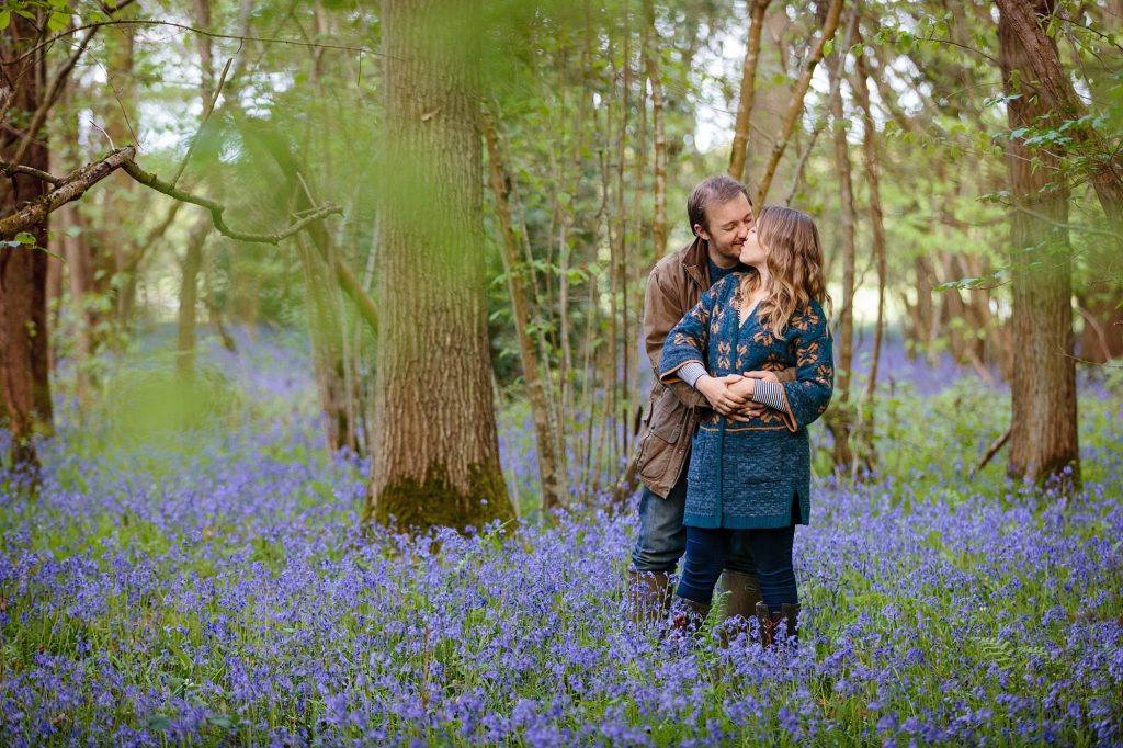spring engagement shoot couple in bluebells