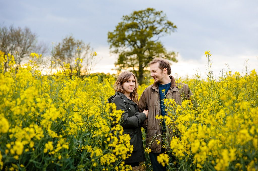 spring engagement shoot in yellow flower field