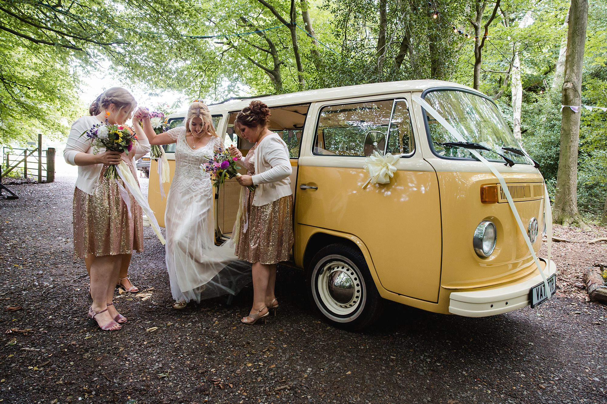 Woodland Weddings Tring bride exits camper van