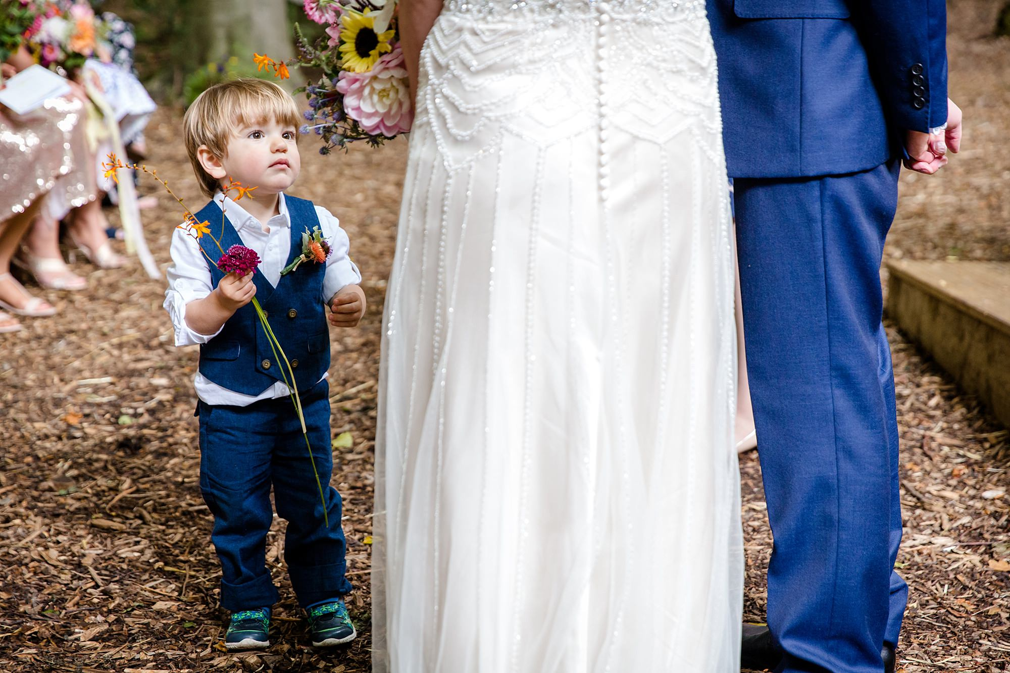 Woodland Weddings Tring pageboy holds flowers