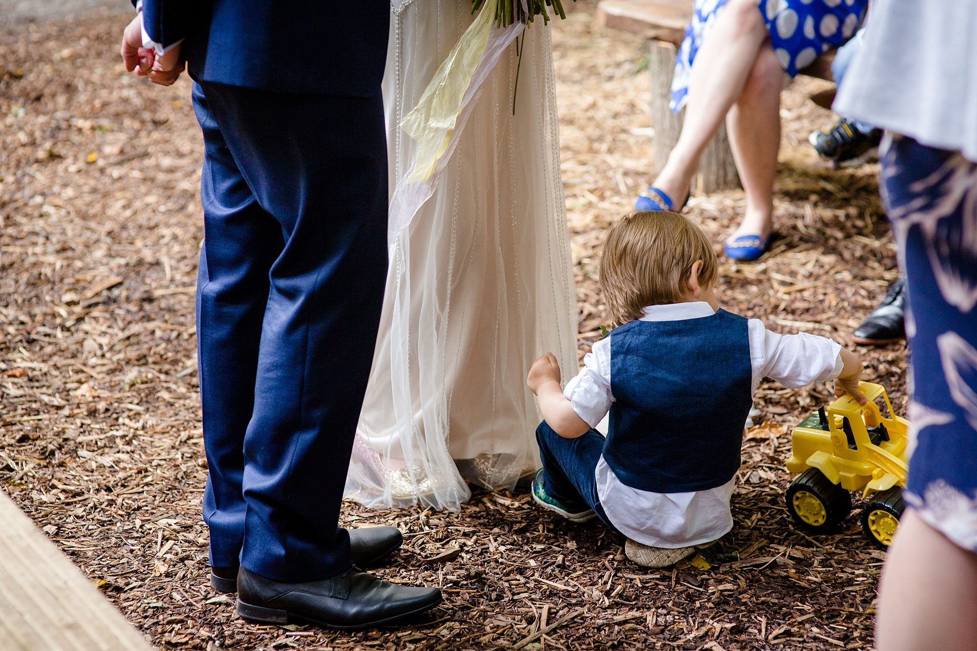 Woodland Weddings Tring page boy plays with truck