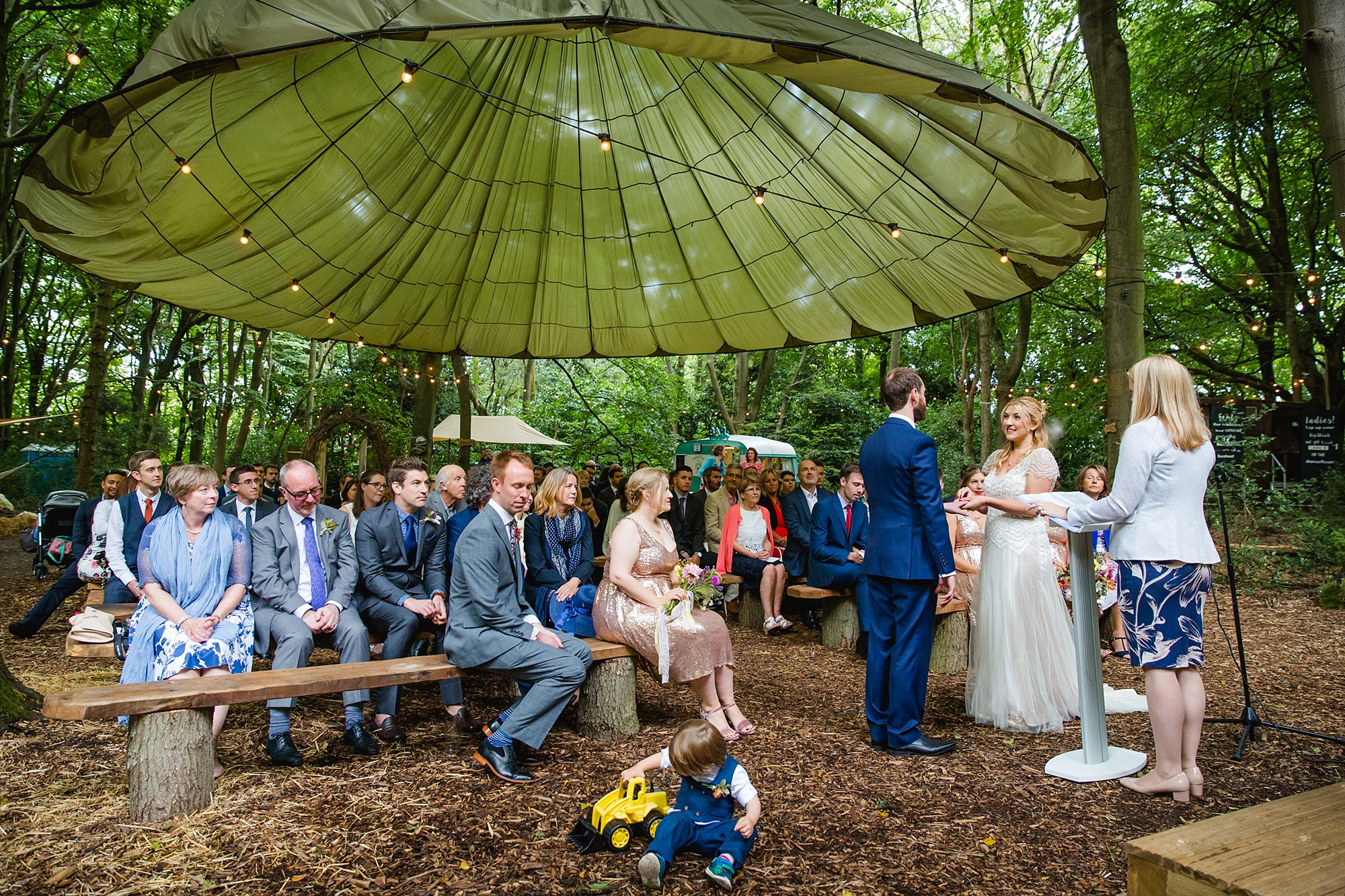 Woodland Weddings Tring bride giving ring to groom