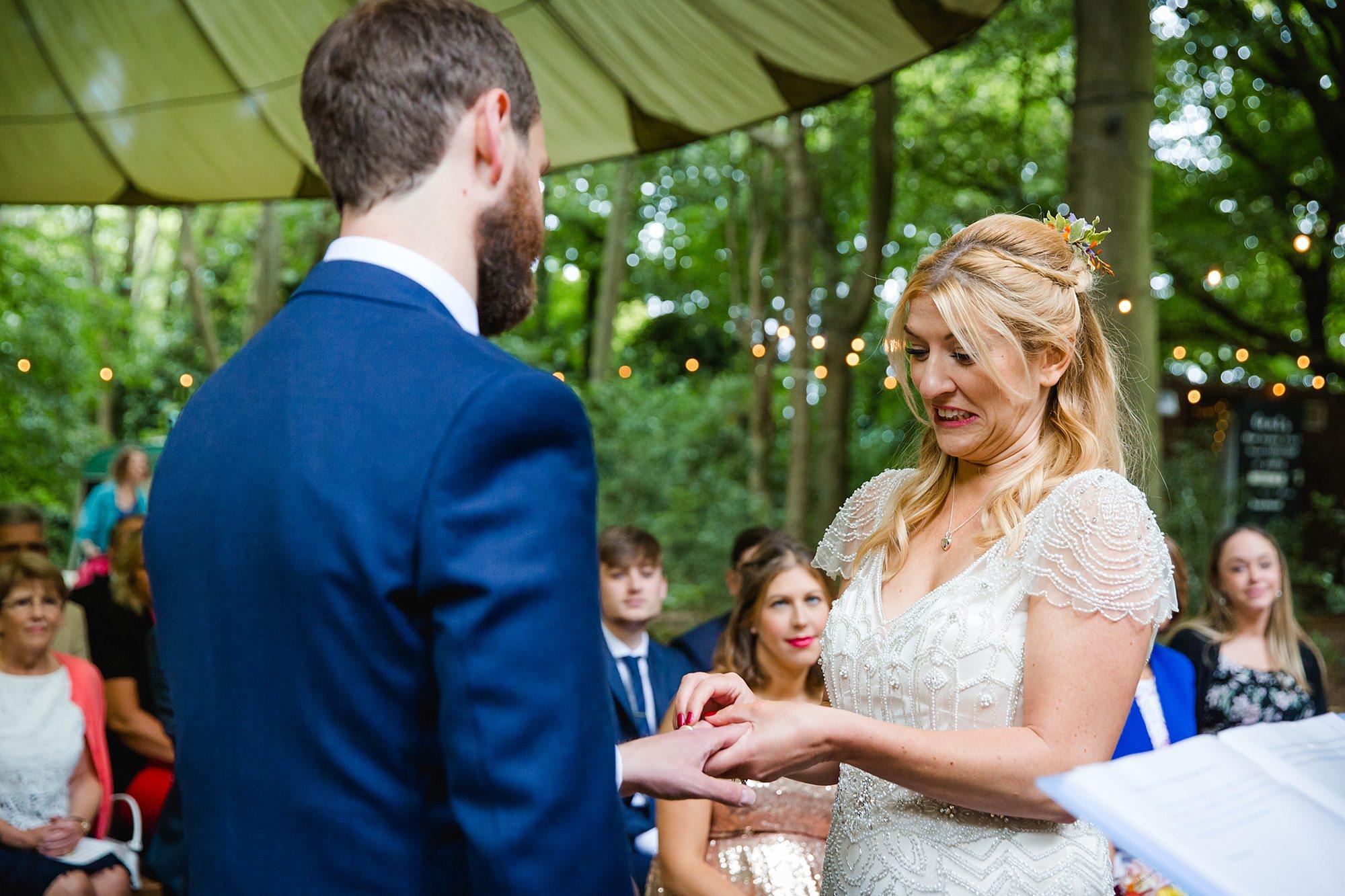 Woodland Weddings Tring bride putting on ring