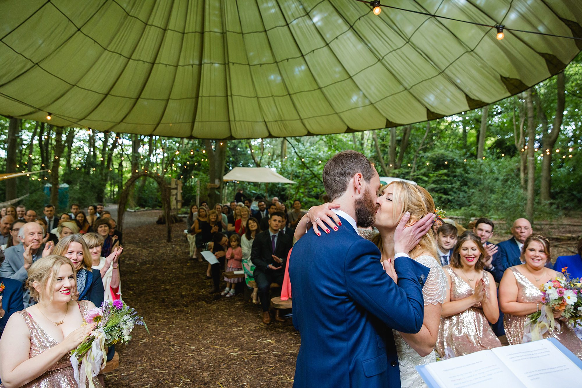 Woodland Weddings Tring bride and groom first kiss