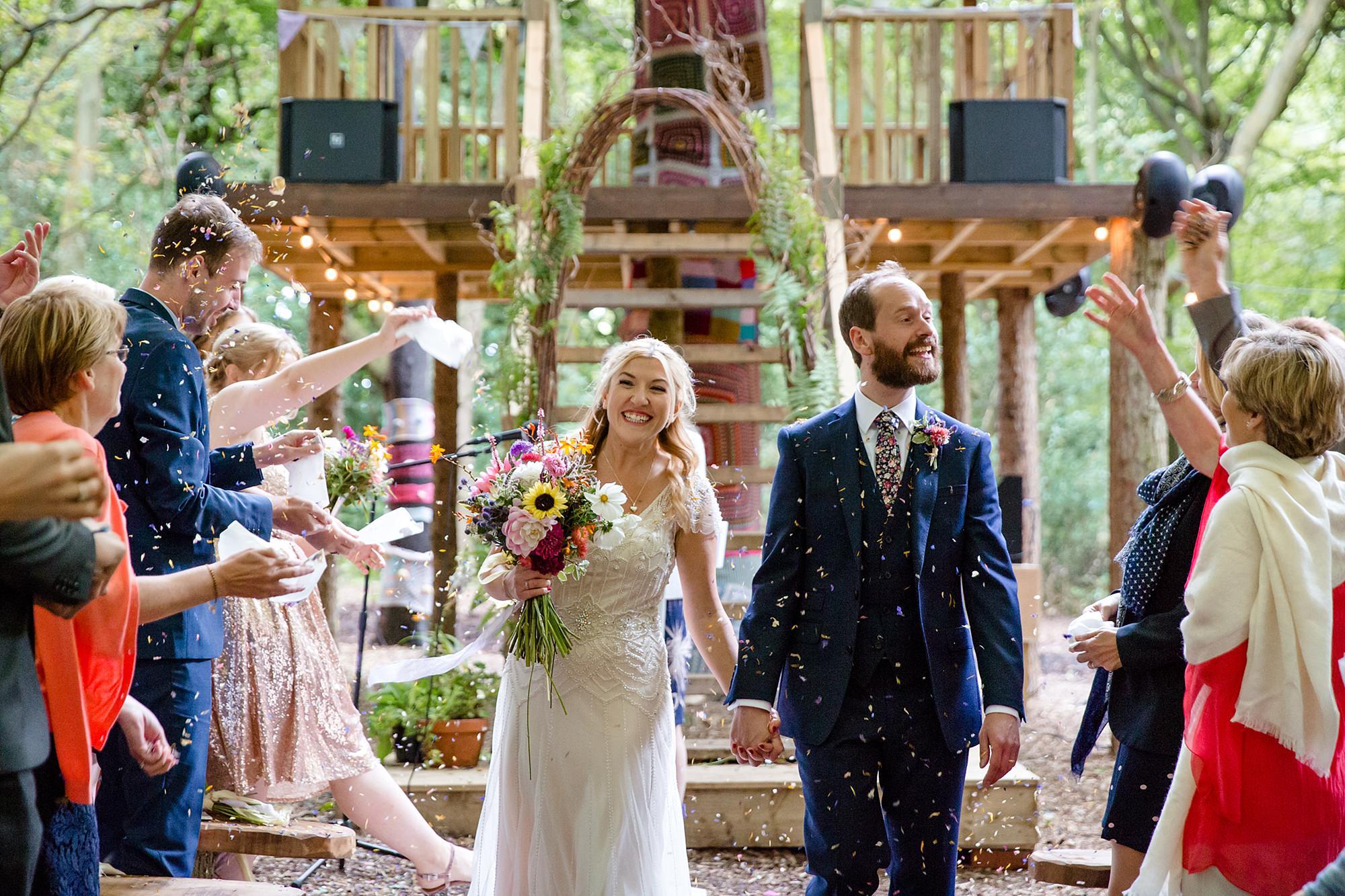 Woodland Weddings Tring bride and groom in confetti
