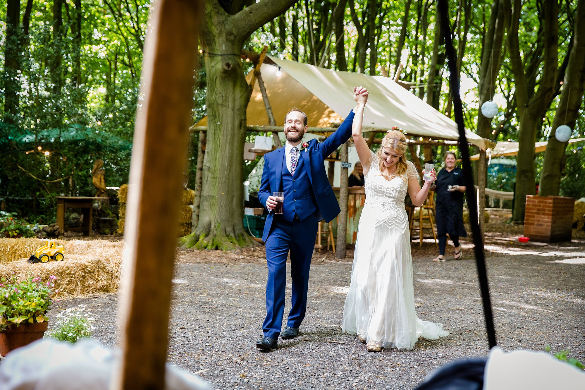 Woodland Weddings Truing bride and groom cheering
