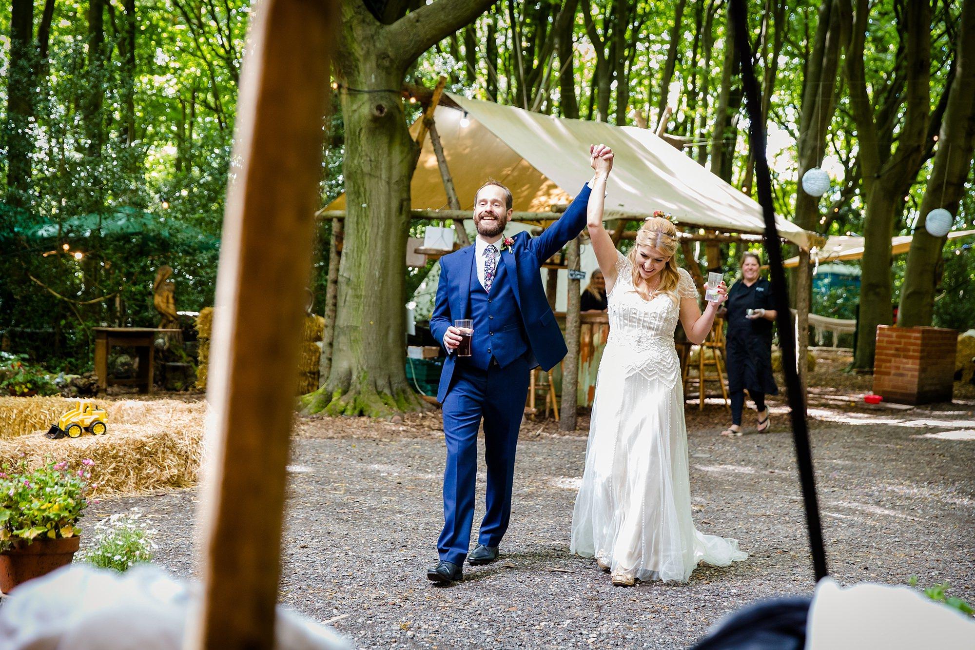 Woodland Weddings Truing bride and groom cheering