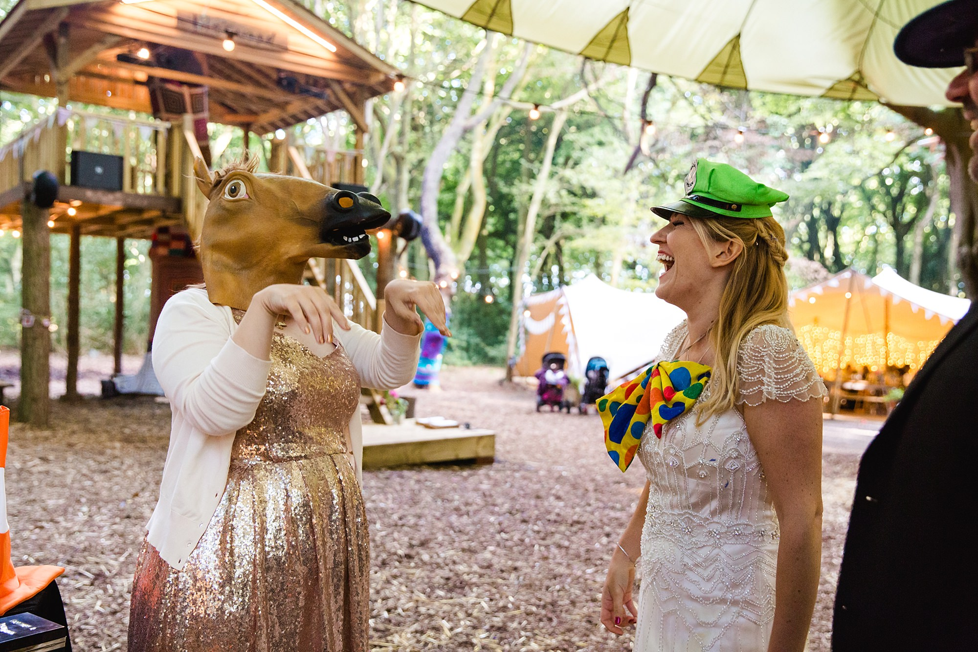 Woodland Weddings Tring bride and bridesmaid with props