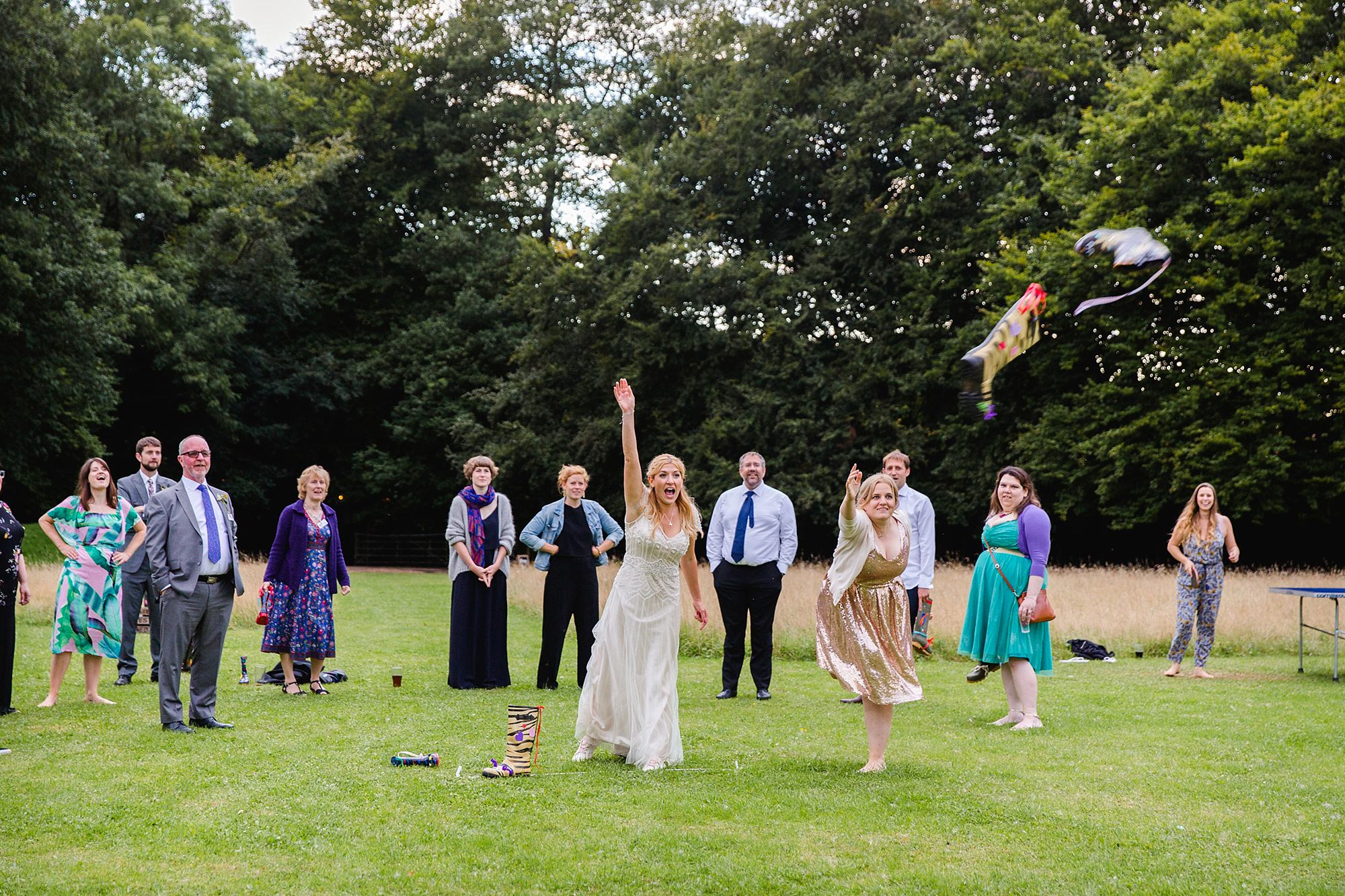 Woodland Weddings Tring bride throwing wellies