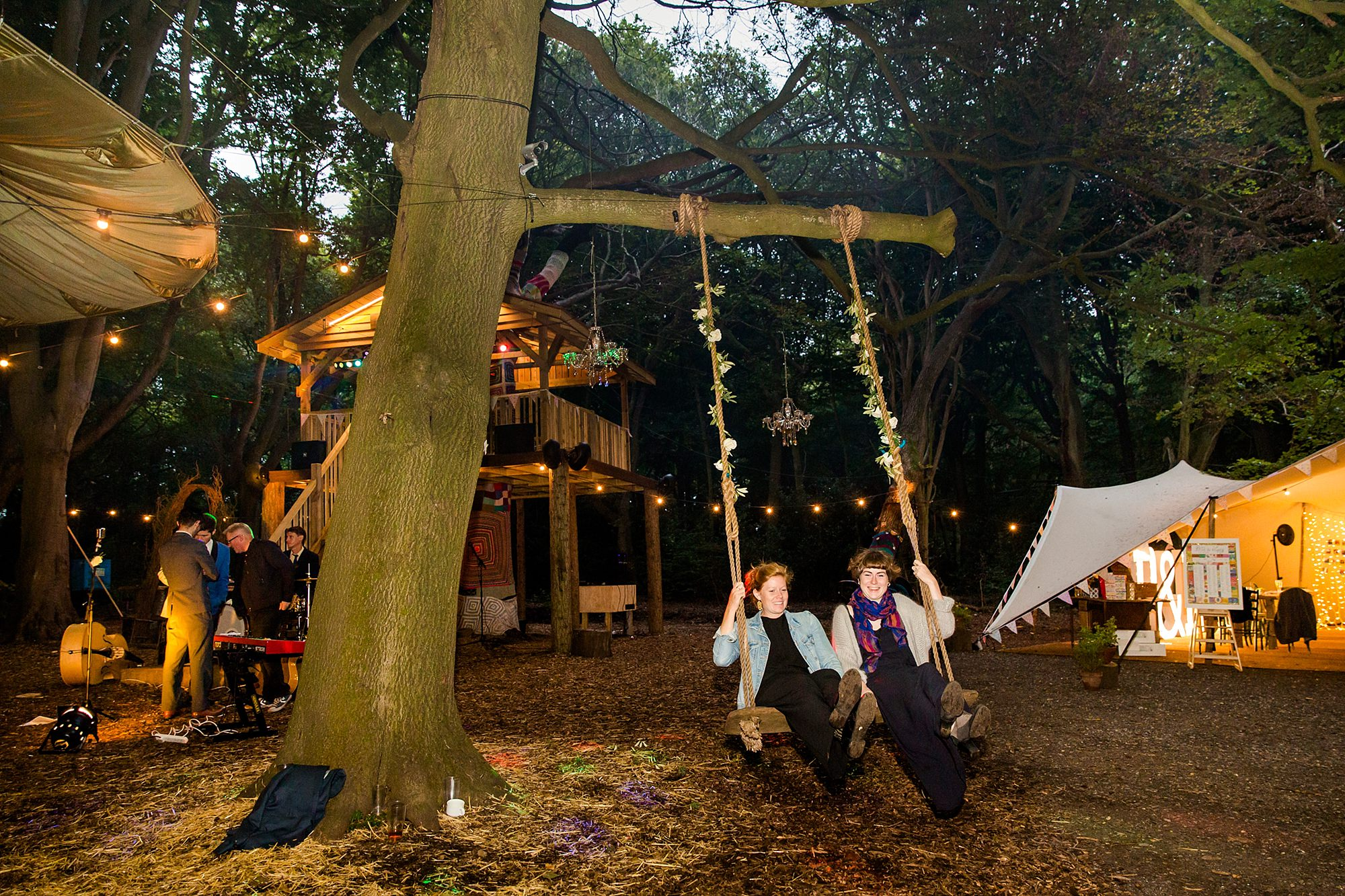 Woodland Weddings Tring wedding guests on swing