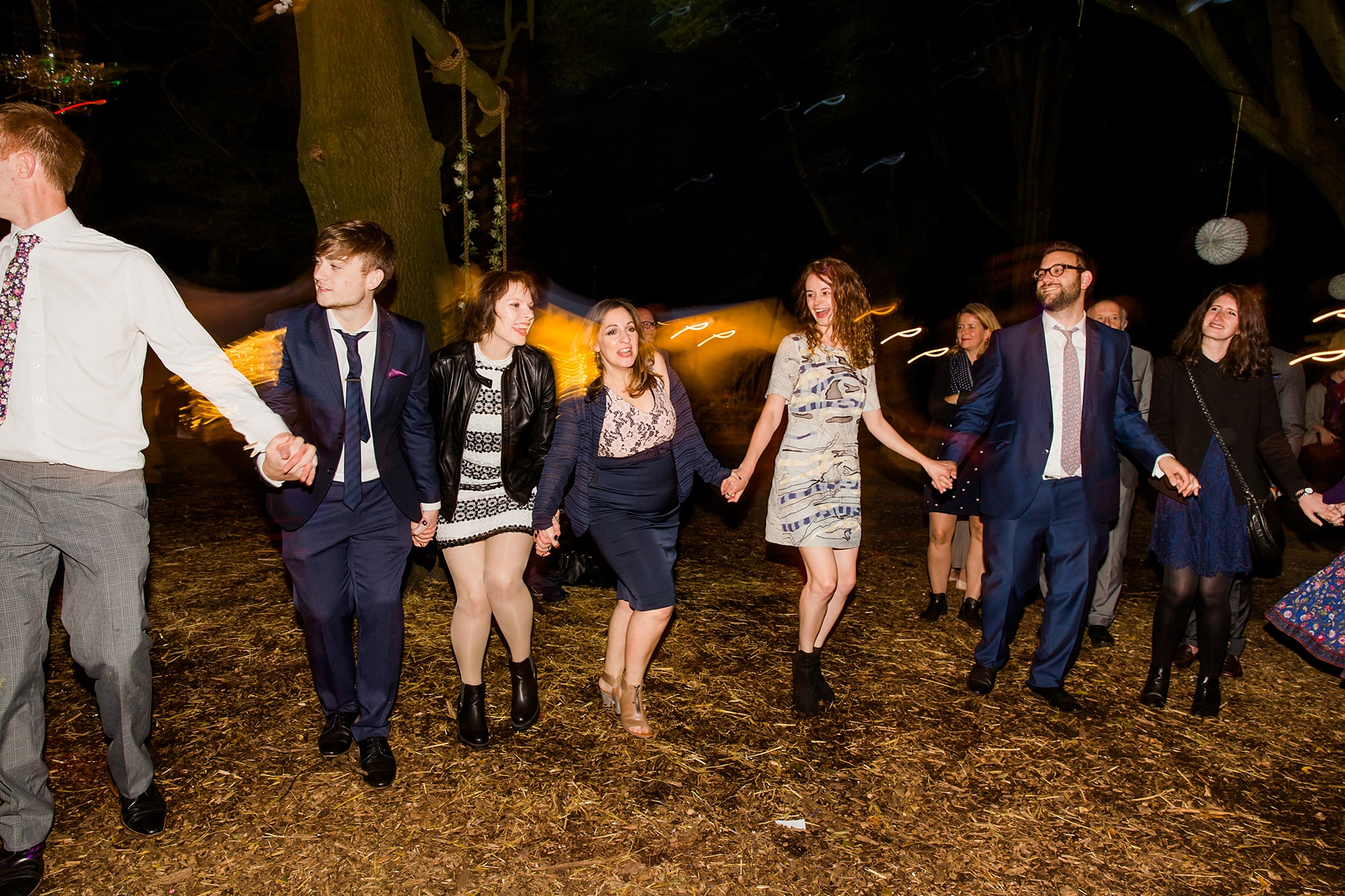 Woodland Weddings Tring guests dancing in circle