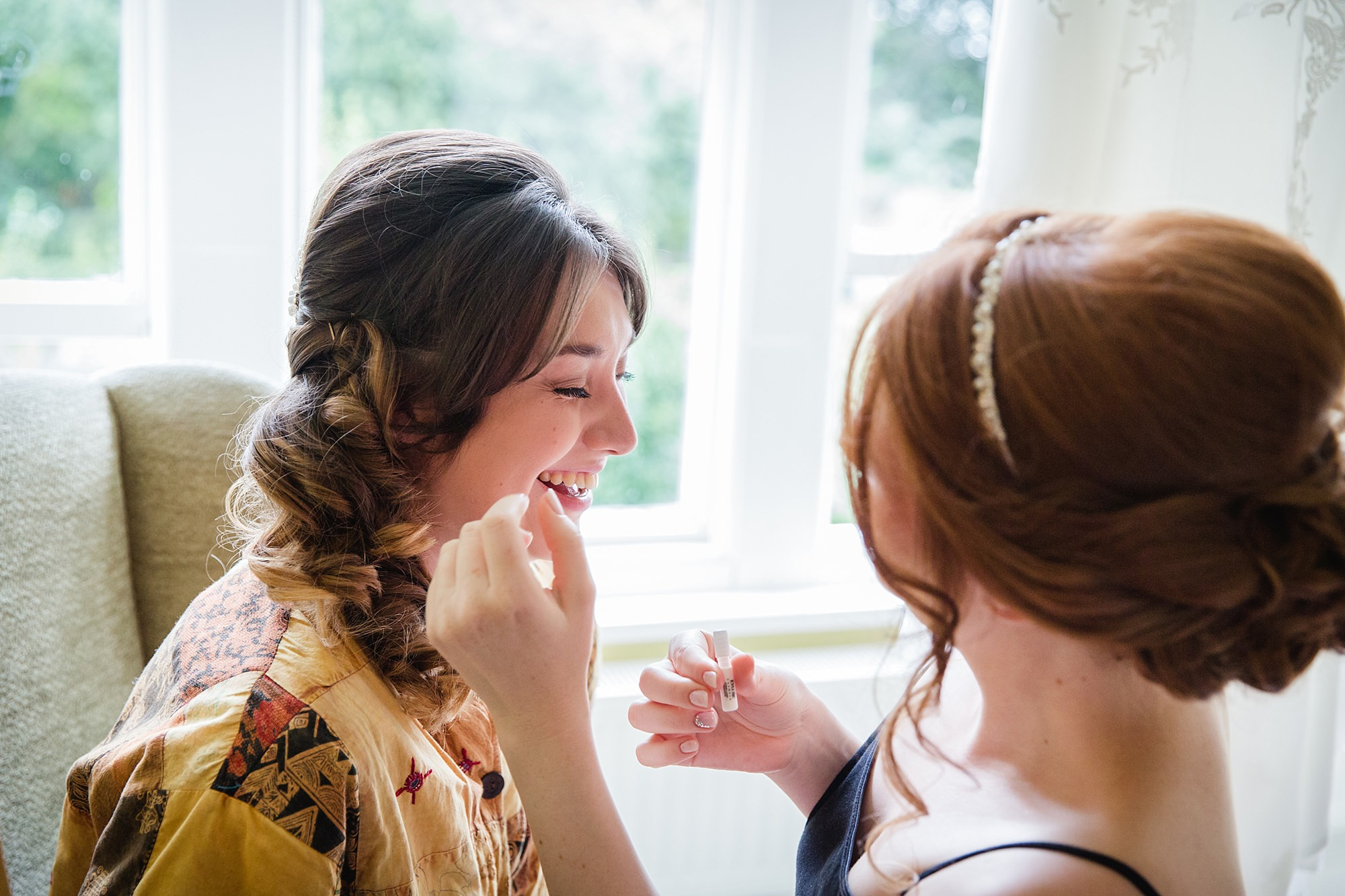 Canon Lane Chichester wedding bride helping bridesmaid