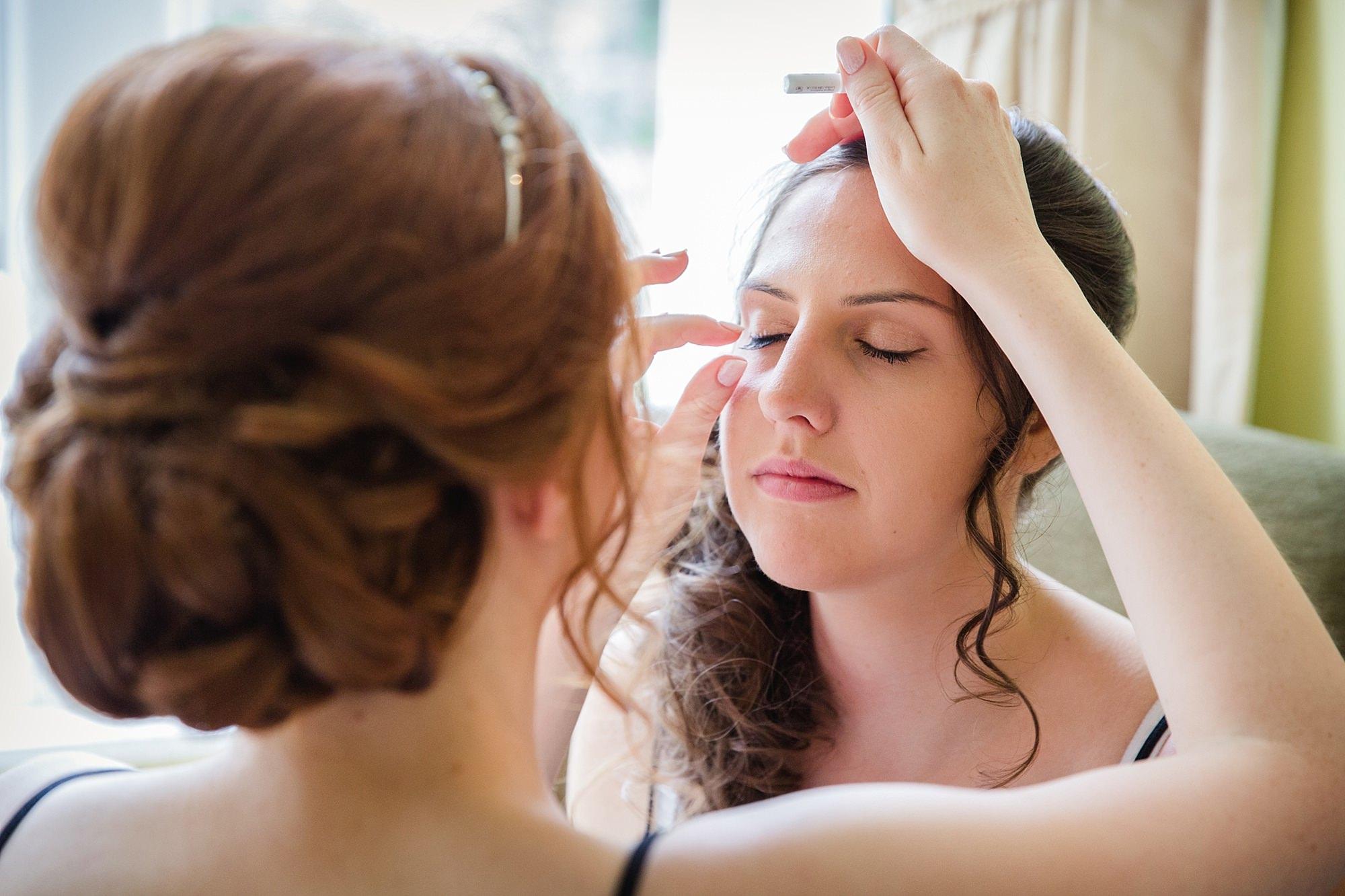 Canon Lane Chichester wedding bridesmaid doing makeup