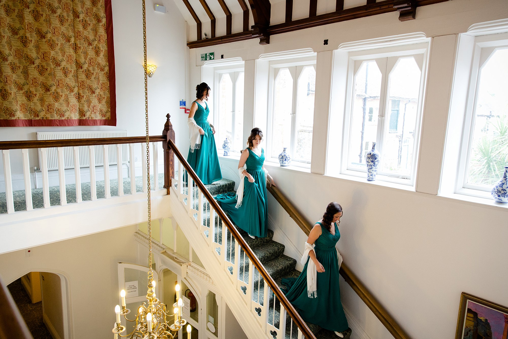 Canon Lane Chichester wedding bridesmaids going down the stairs