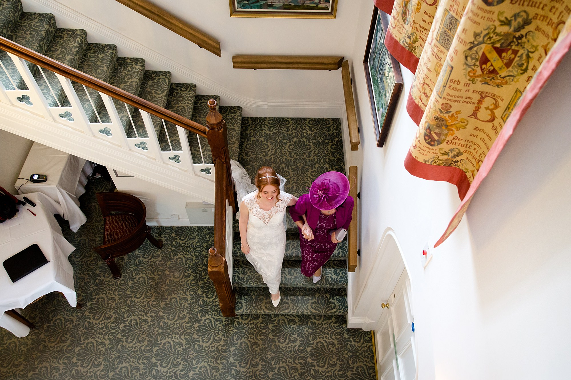 Canon Lane Chichester wedding bride going downstairs with her mother
